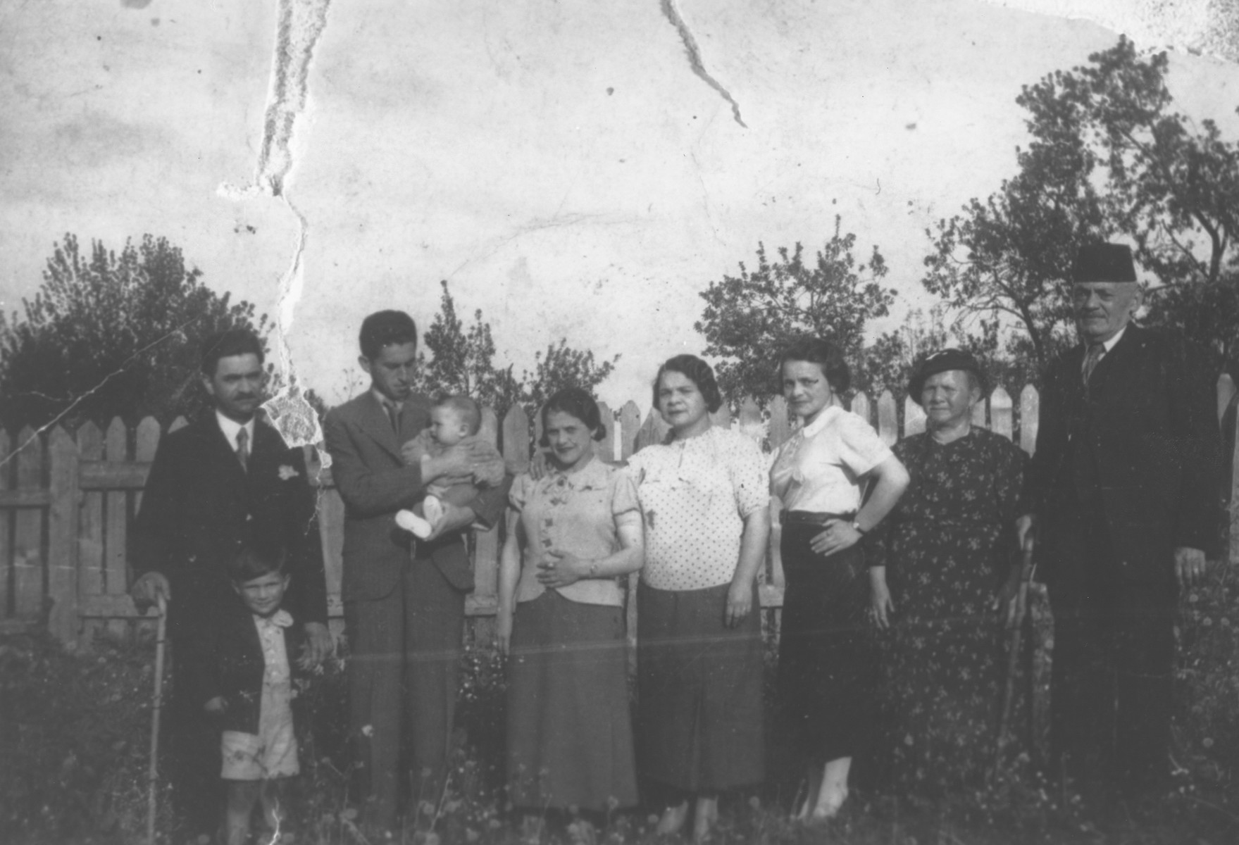 Group portrait of members of the extended Altarac family outside their home in Vlasenica, Bosnia.