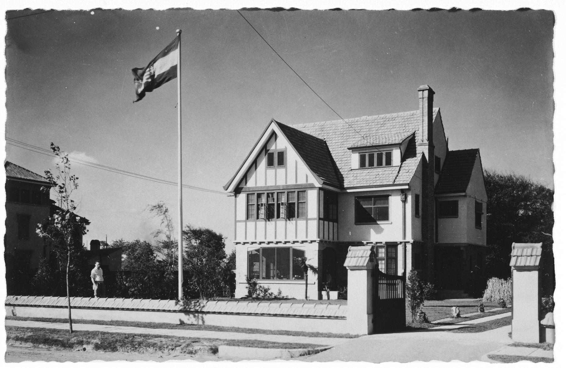 A Hungarian flag flies in front of the residence of the Komor family at 92 Amherst Road in Shanghai.  Designed by Hungarian architect Wladislaus Hudec, the Komor home was built in 1929.