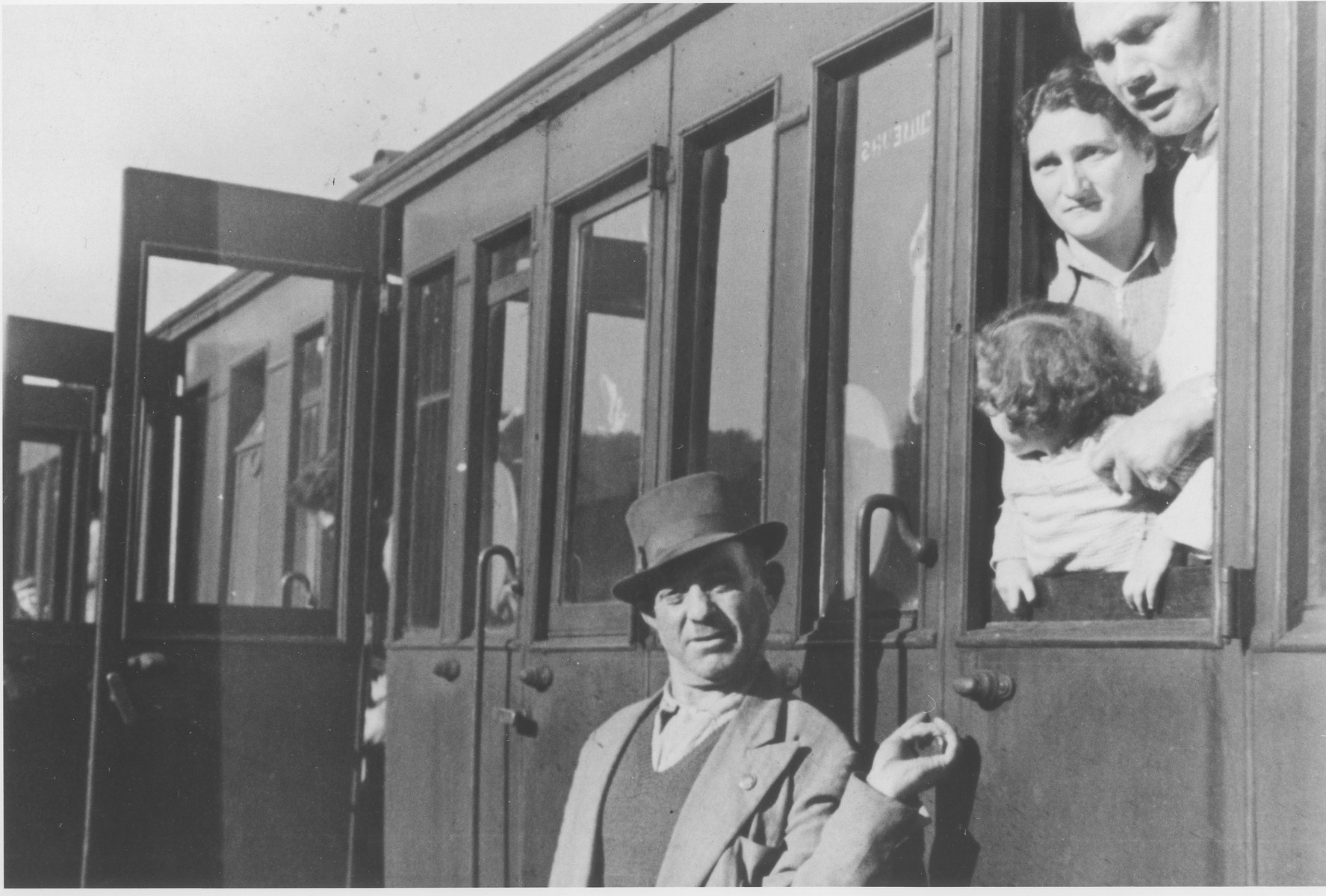Former Exodus passengers look out from a Bricha train on their return trip to France following their internment in the Poppendorf displaced persons camp.