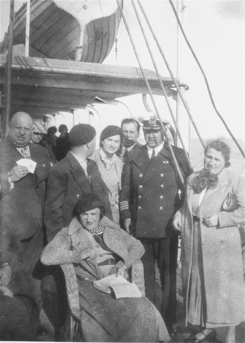 Jewish couples from the Balkans on board a ship during a sightseeing excursion to Palestine.  Among those pictured are Beno and Blanka Kupfermann (center, behind the seated woman).