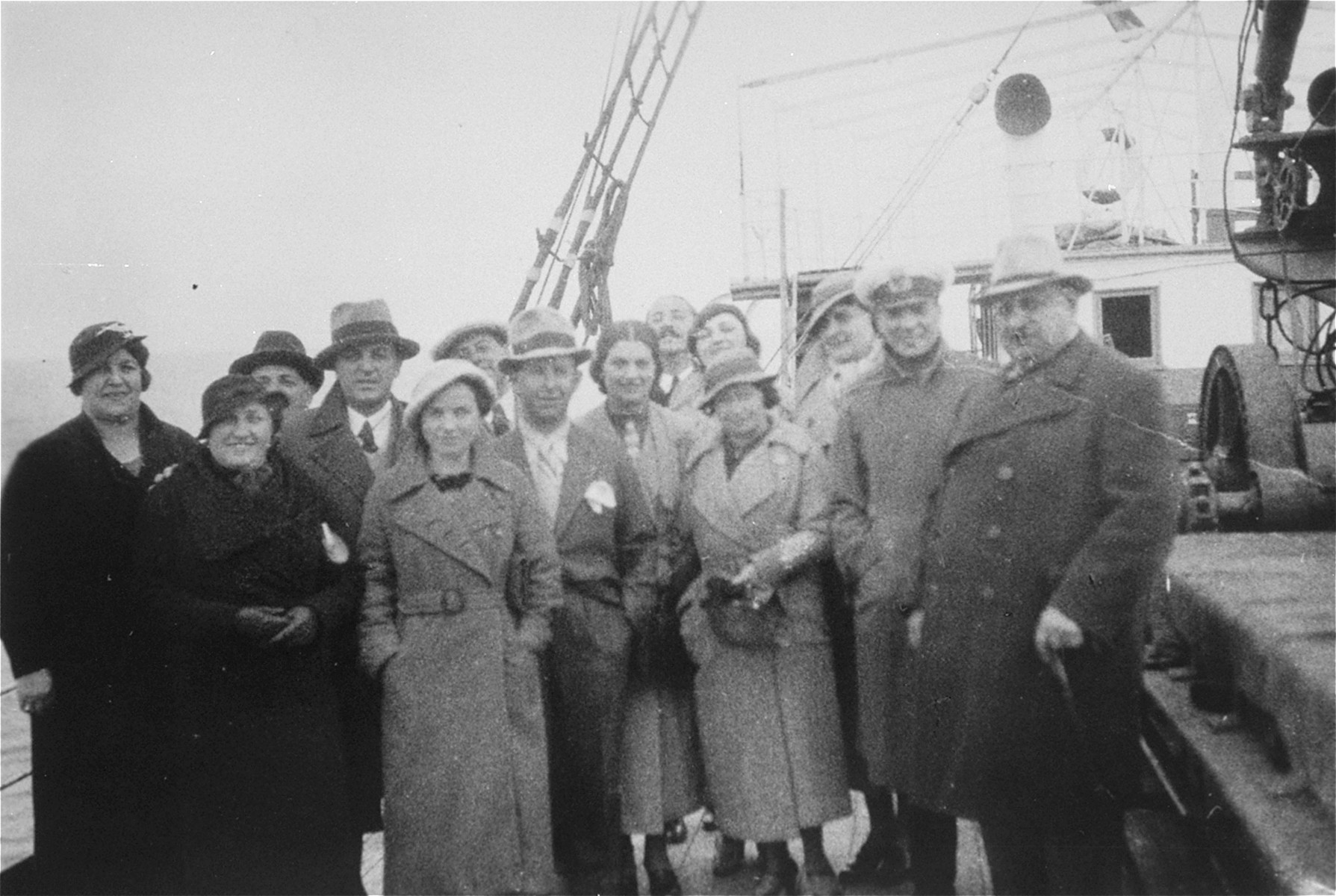Group portrait of Jewish couples from the Balkans on board a ship during a sightseeing excursion to Palestine.  Among those pictured are Beno and Blanka Kupfermann (center).