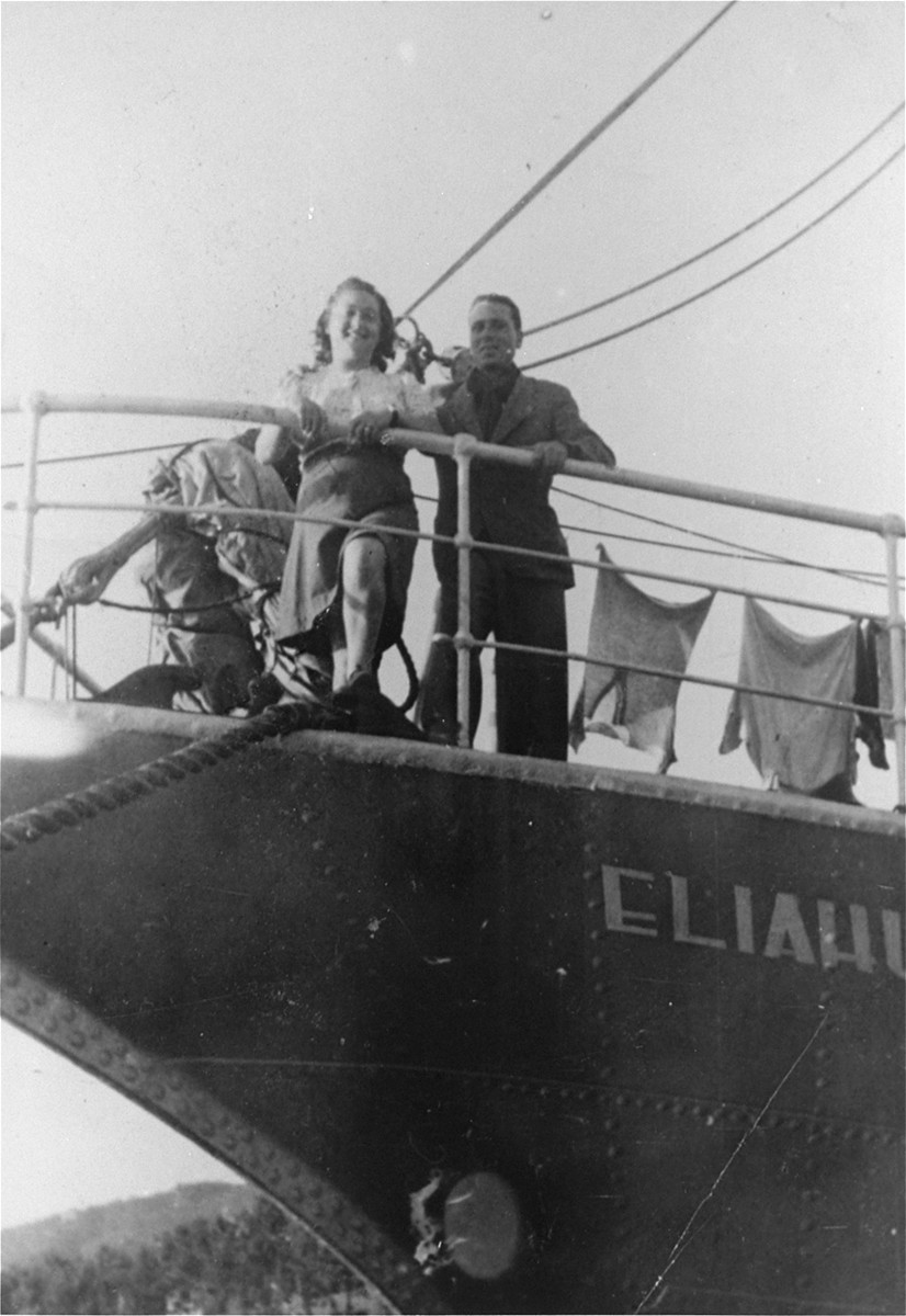 Hadasa Werdygier stands with an Italian Jew on the deck of the Dov Hos right before it set sail for Palestine.