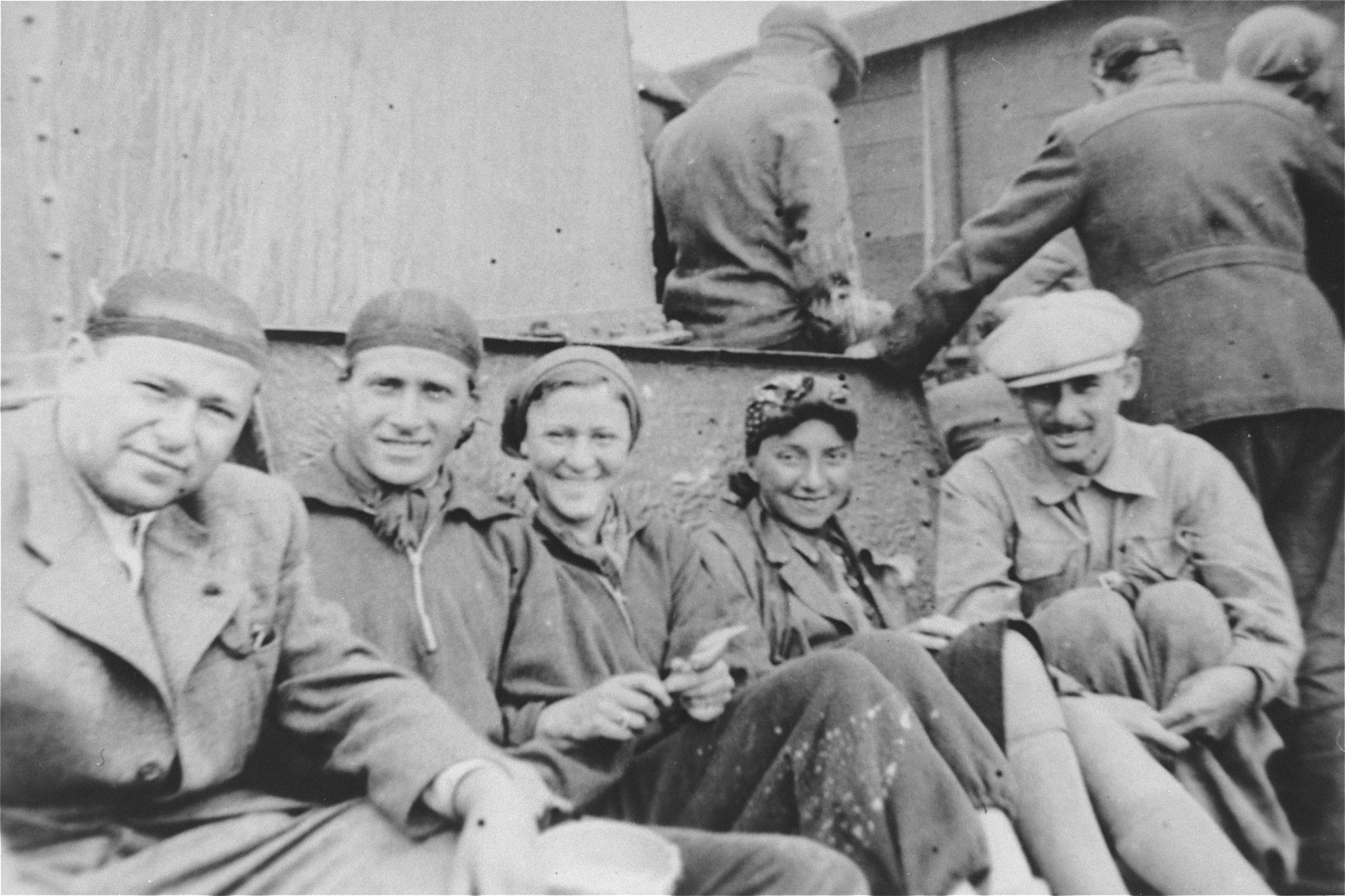 Group portrait taken of the Rettinger family with friends on board the Aegus Nicolau en route to Palestine.