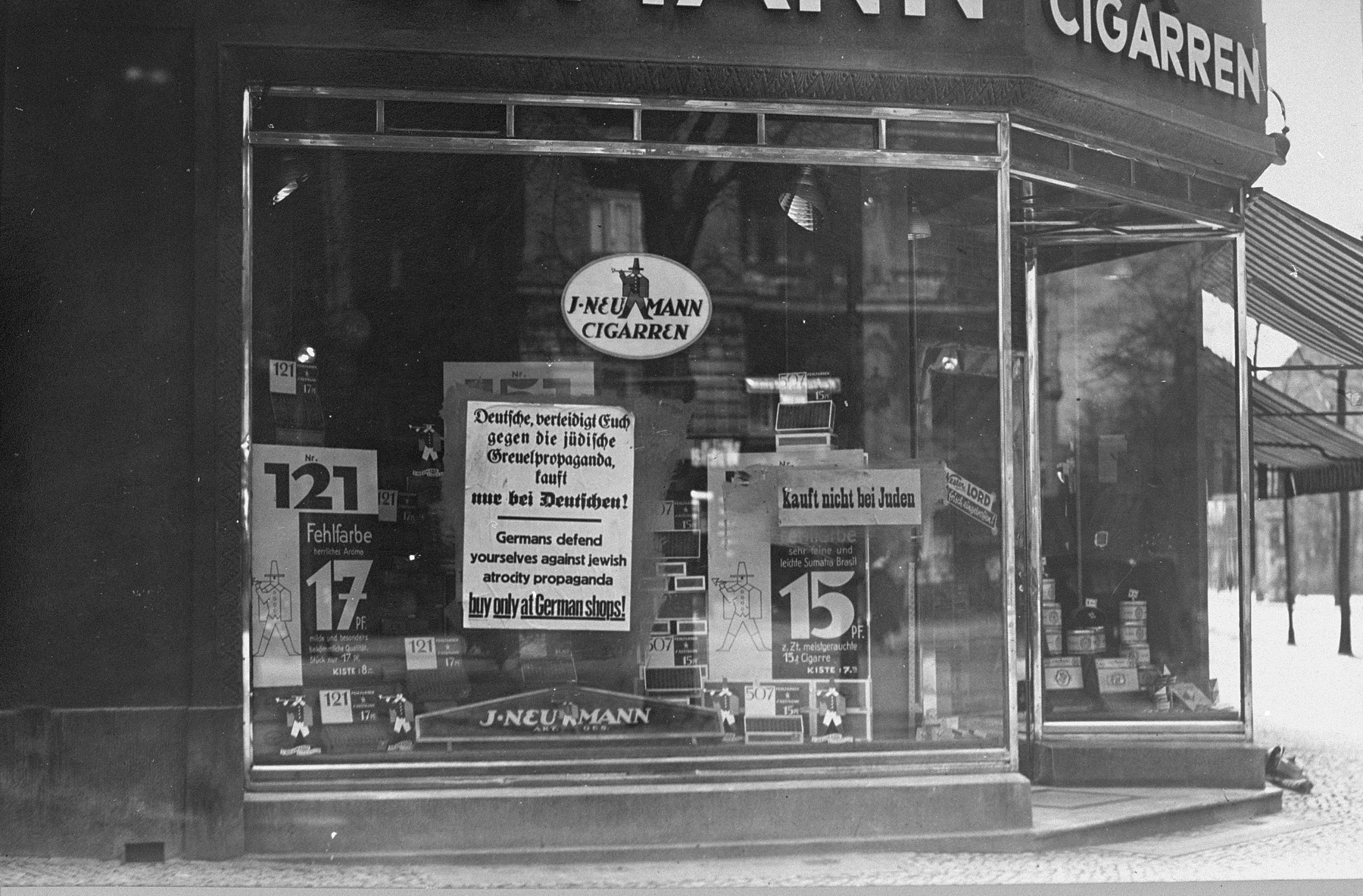 Boycott signs posted in the window of J. Neumann Cigarren, a Jewish-owned tobacco store in Berlin.