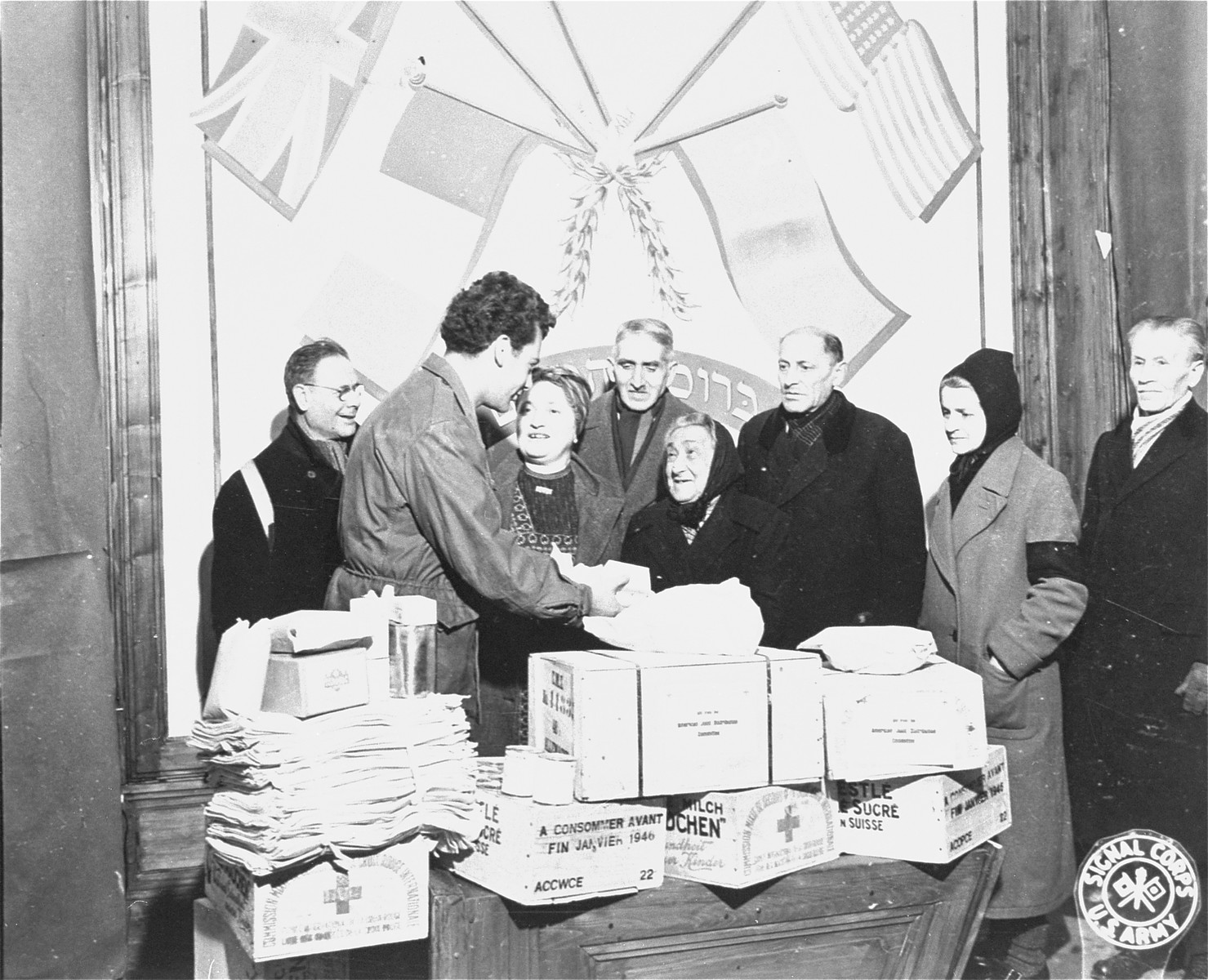 Harry Weinsaft of the American Jewish Joint Distribution Committee, distributes Red Cross packages to Jewish DPs in Vienna.