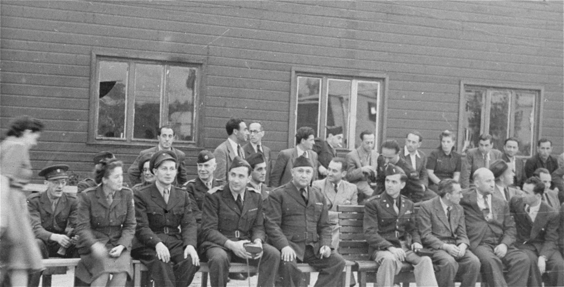 Officials of various agencies attend a ceremony at the Schlachtensee displaced persons camp in Berlin.    Among those pictured in the front row are: Chaim Chonowitz of the Jewish Agency for Palestine (second from the left); Eli Rock, JDC director for Berlin (third from the left); Harold Fishbein, UNRRA director of the Schlachtensee camp (fourth from the left); Chaplain Mayer Abramowitz (fifth from the left) and Szwartzberg, president of the central committee of Schlachtensee.