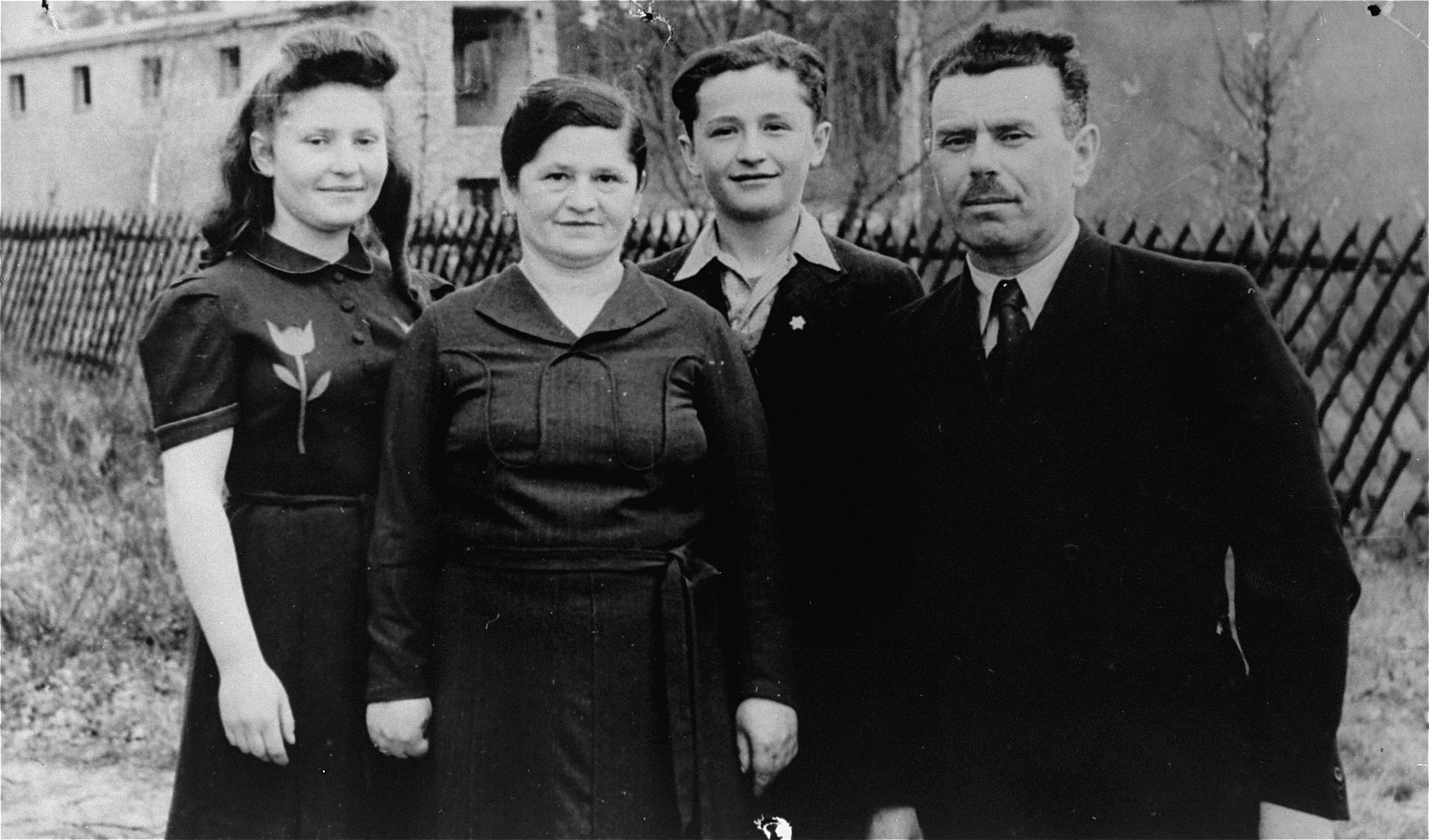 Portrait of the Gliklich family in the Schlachtensee displaced persons camp in Berlin-Duppel.    Pictured are the donor, Lusia Gliklich (far left) with her father and mother, Gershon and Shifra Gliklich, and her younger brother Moniek.