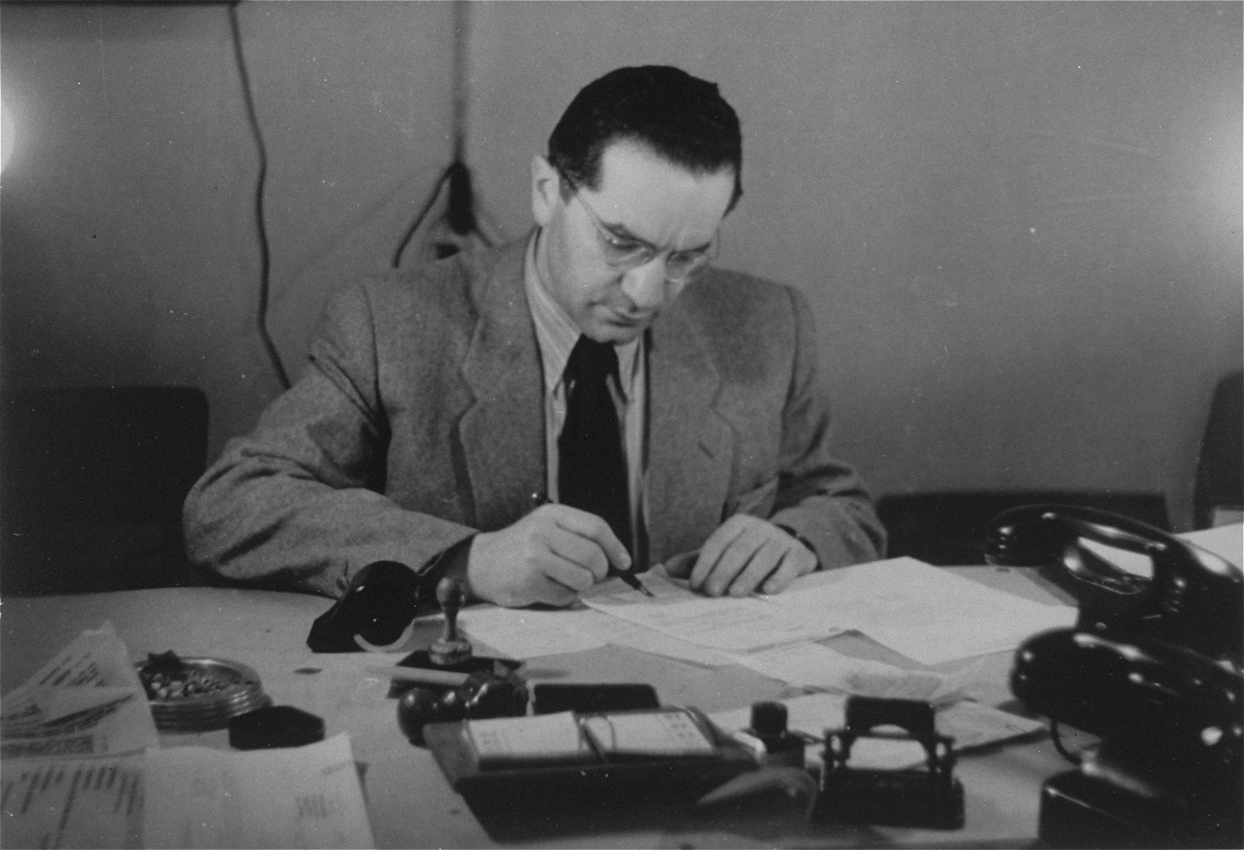 Chief medical officer, Dr. Naum Wortman, at his desk in the Ebelsberg displaced persons camp.