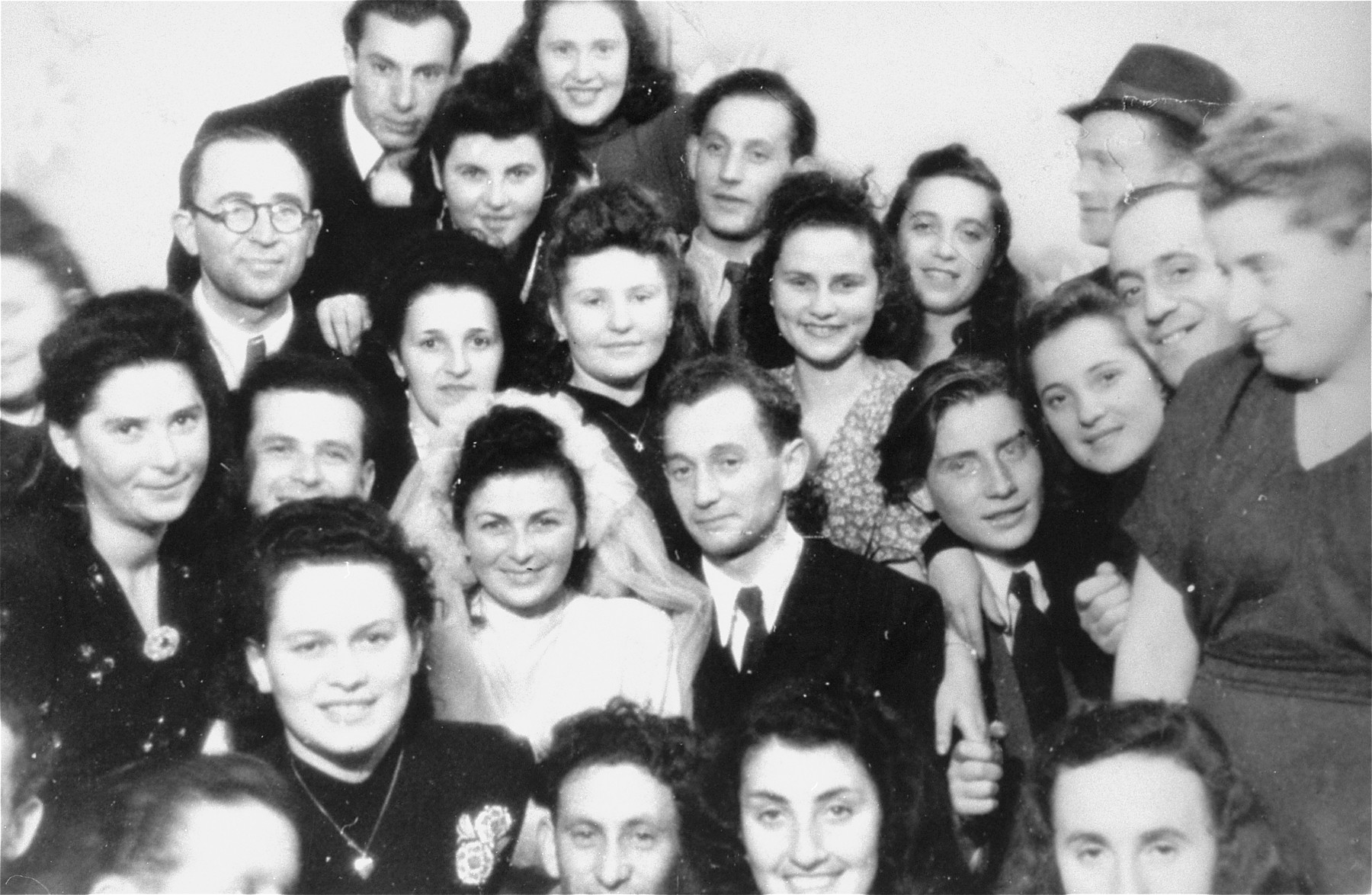 Friends celebrate the wedding of Fela Wasserman n the Schlachtensee displaced persons camp.    Also pictured are Goldi Bimbad, Abraham Wasserman, Lusia Gliklich, Pepa Gold, Kaja Kuper, and Chumka Gleiberman.