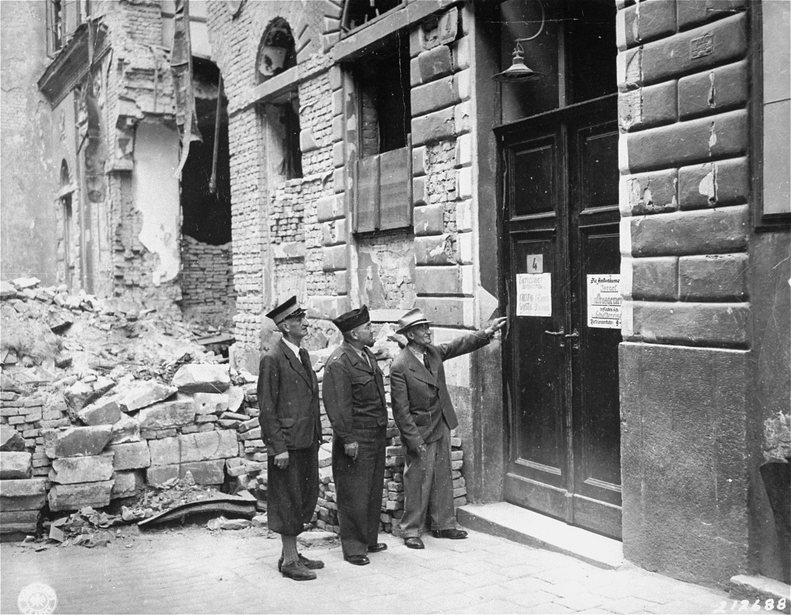 View of the synagogue at 4 Seitenstettengasse in Vienna.  A sign on the door indicates when religious services are held.  This was the only synagogue that was not destroyed in Vienna during Kristallnacht.