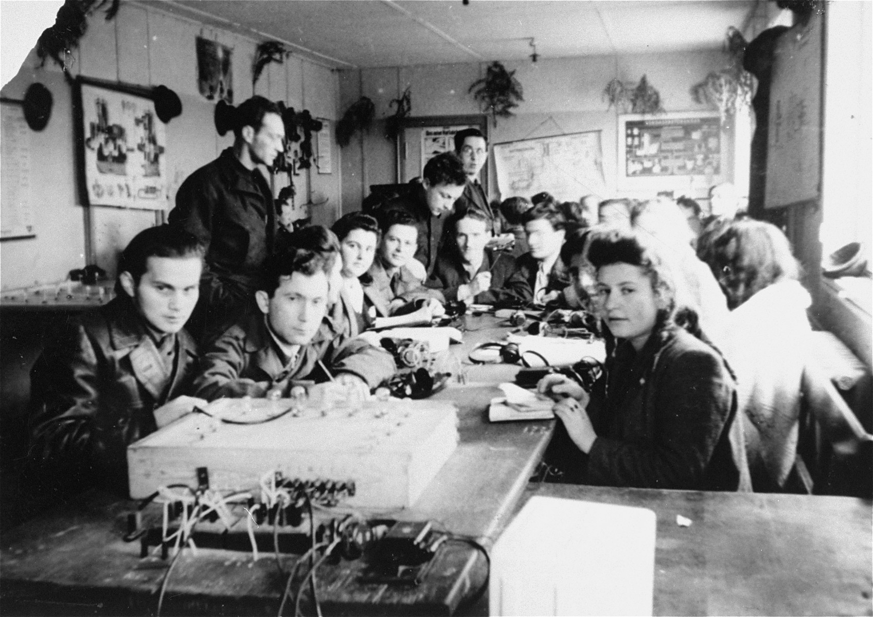 Young men and women attend a  radio telegraph class at the ORT school in the Schlachtensee displaced persons camp.    Students pictured include Murka Bimbad, Lusia Gliklich, George Kupper, Abraham Wasserman, Icka Engelczyn, and ? Zycer.