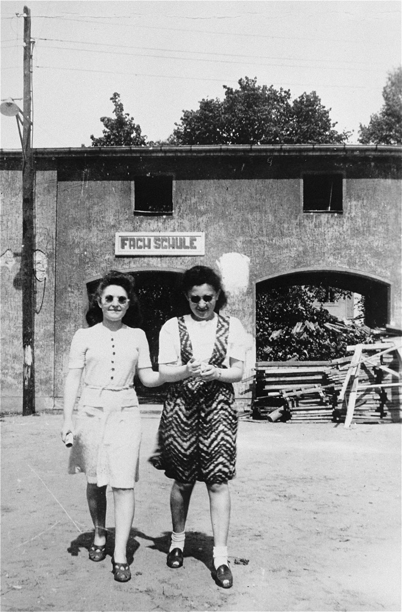 Lusia Gliklich (left) and Mina Cymmerman walk in front of the ORT school at the Schlachtensee displaced persons camp.
