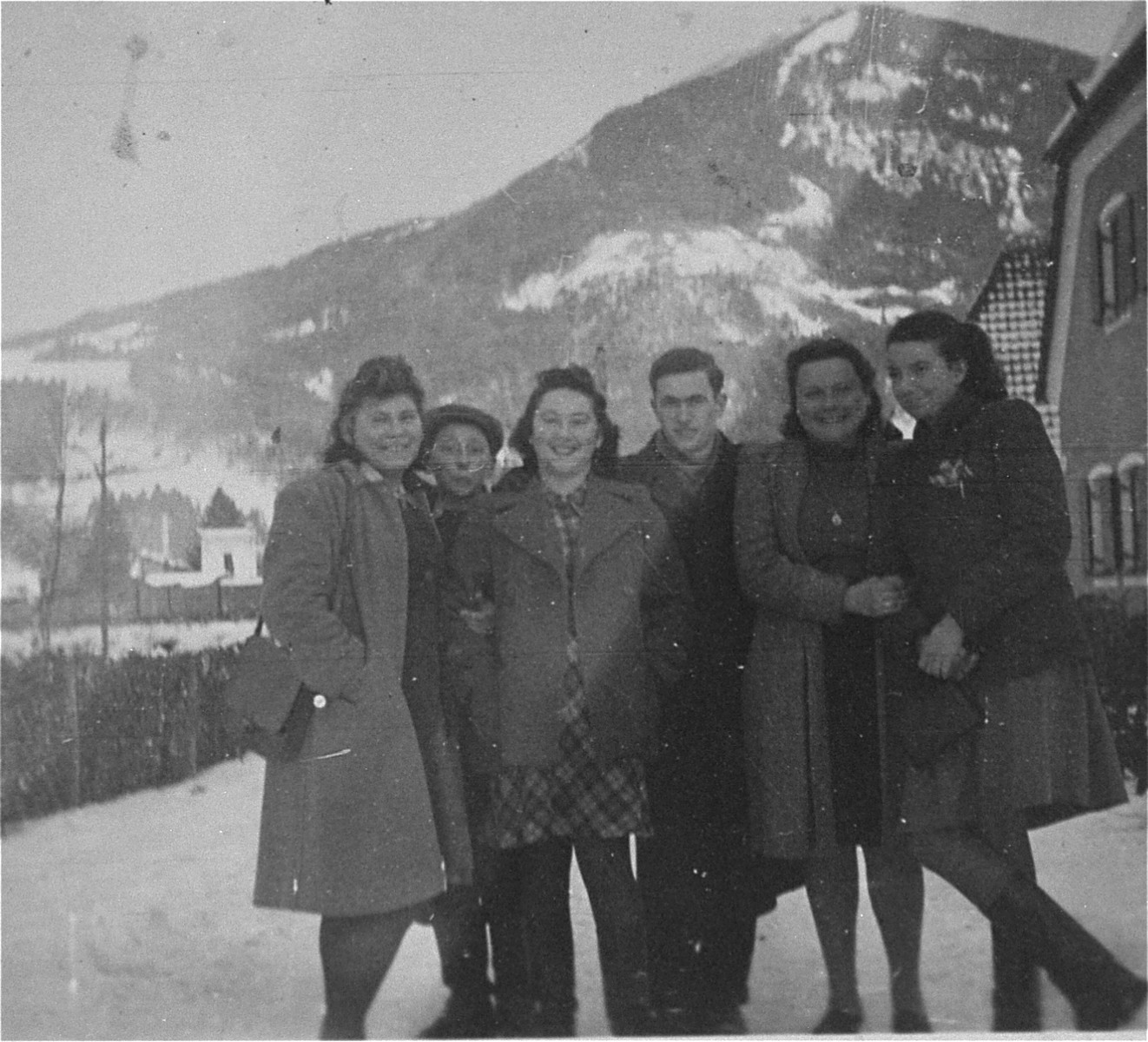 Group portrait of young Jewish DPs from the Salzburg displaced persons camp on an outing in the mountains.  Pictured from left to right are Ester Himmelfarb, unknown, Hadasa Werdygier, unknown,  Helen Rubinsztajn, and Mania Potok.  The last four were from Bedzin, Poland.