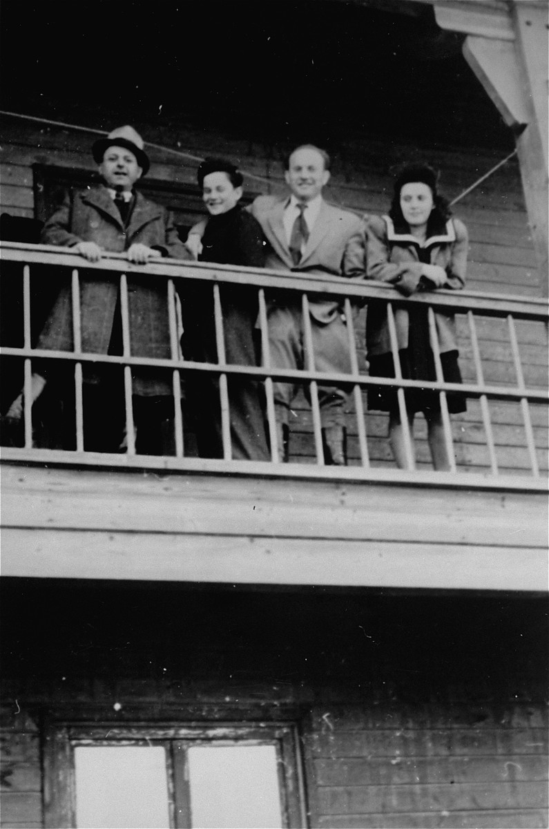 Andzia Dell and three other DPs watch a ball game from a balcony in Schlachtensee displaced persons camp.