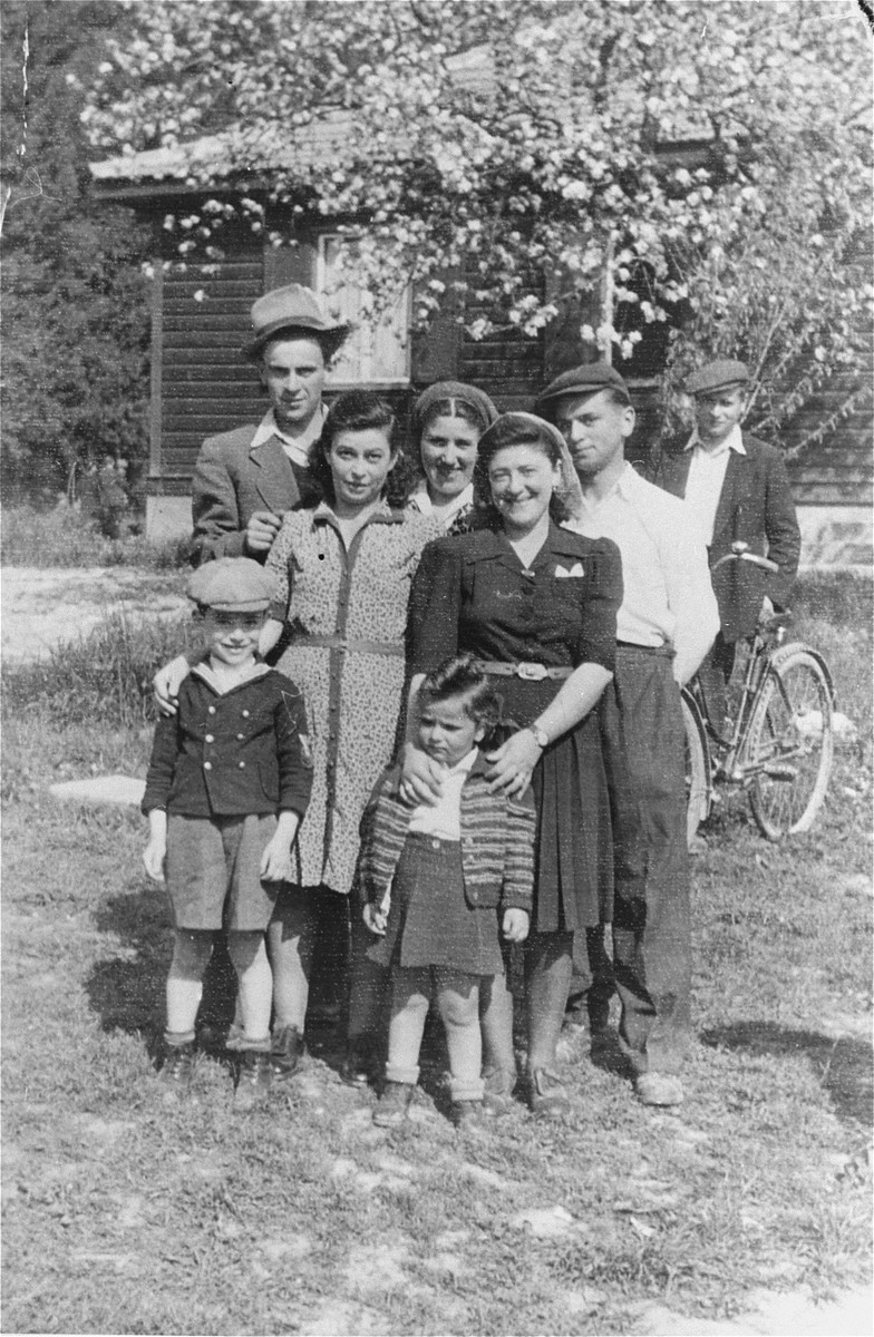 Group portrait of members of the Reich family from Rzeszow at the Salzburg displaced persons camp.  The family survived the war in hiding in Rzeszow.