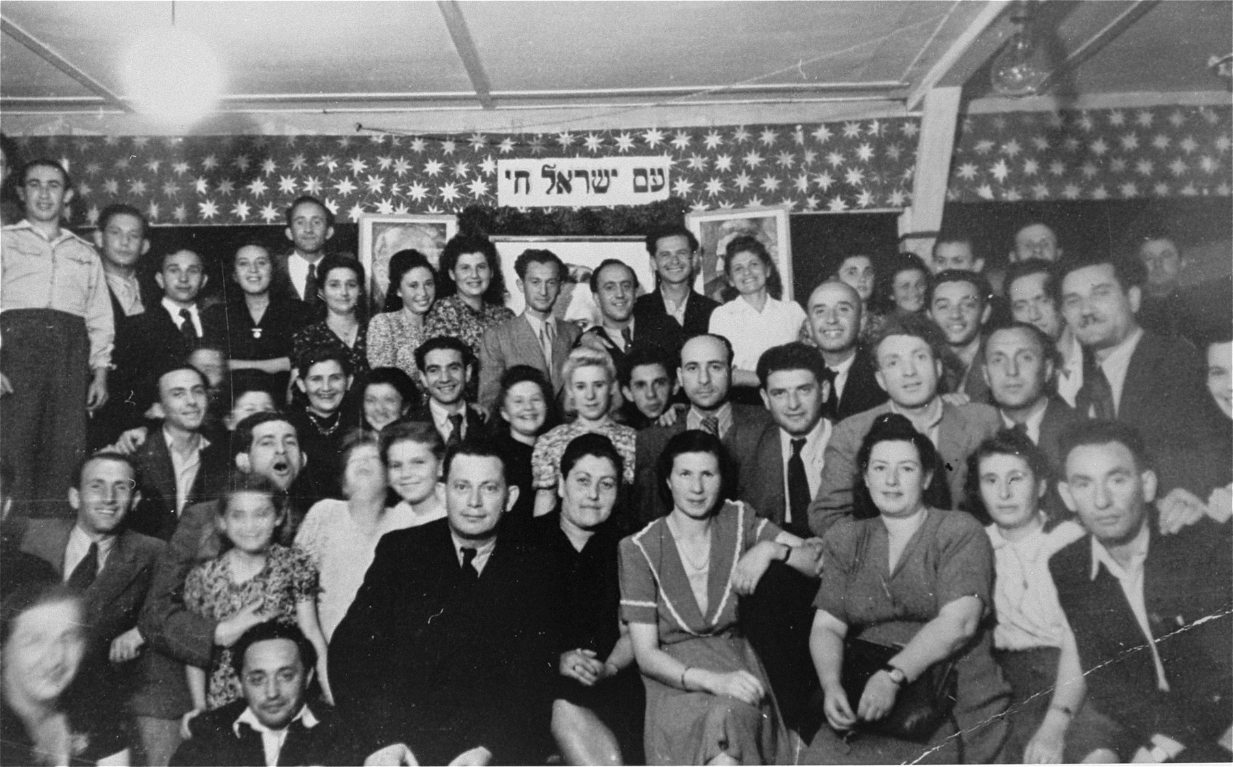 Group portrait of residents of the Schlachtensee displaced persons camp.    Those pictured include Goldi Bimbad, Murka Bimbad, Abraham Wasserman, and Lusia Gliklich.