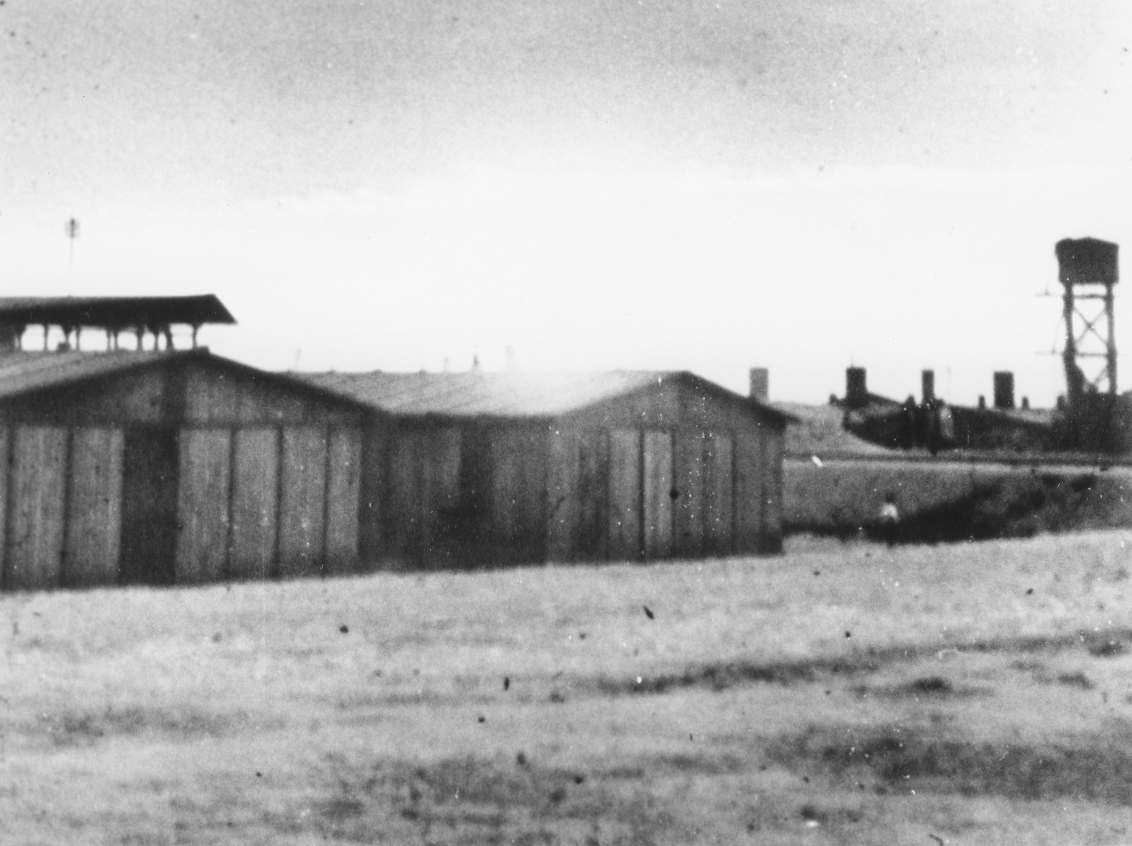 View of the Trawniki training camp showing two barracks and a watch tower.