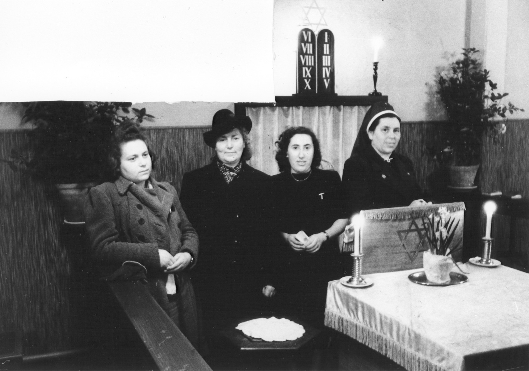 Four women sit in the chapel at U.S. Army 3rd Division headquarters in Bad Wildungen.  Pictured at the far right is Hilde Hammerschlag, a survivor from Bad Wildungen.