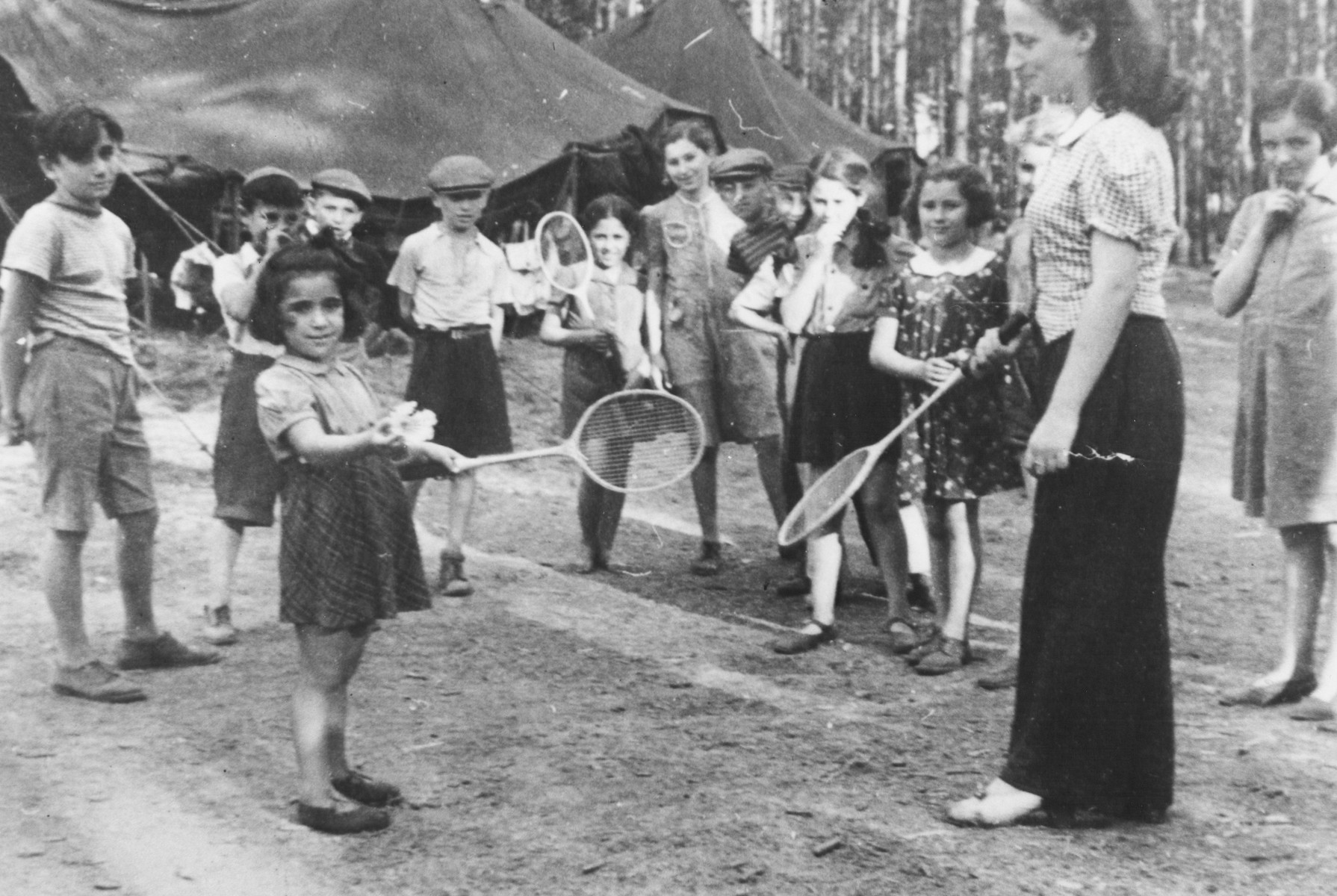 Children from the Schlachtensee and Tempelhof displaced persons camps play badmitten at a summer camp for Jewish DP children in the Grunewald Forest.
