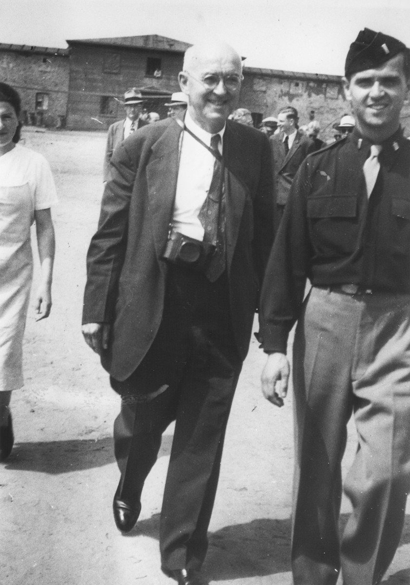 U.S. Army chaplain Rabbi Mayer Abramowitz (right) escorts a member of a visiting international commission in the Schlachtensee displaced persons camp.