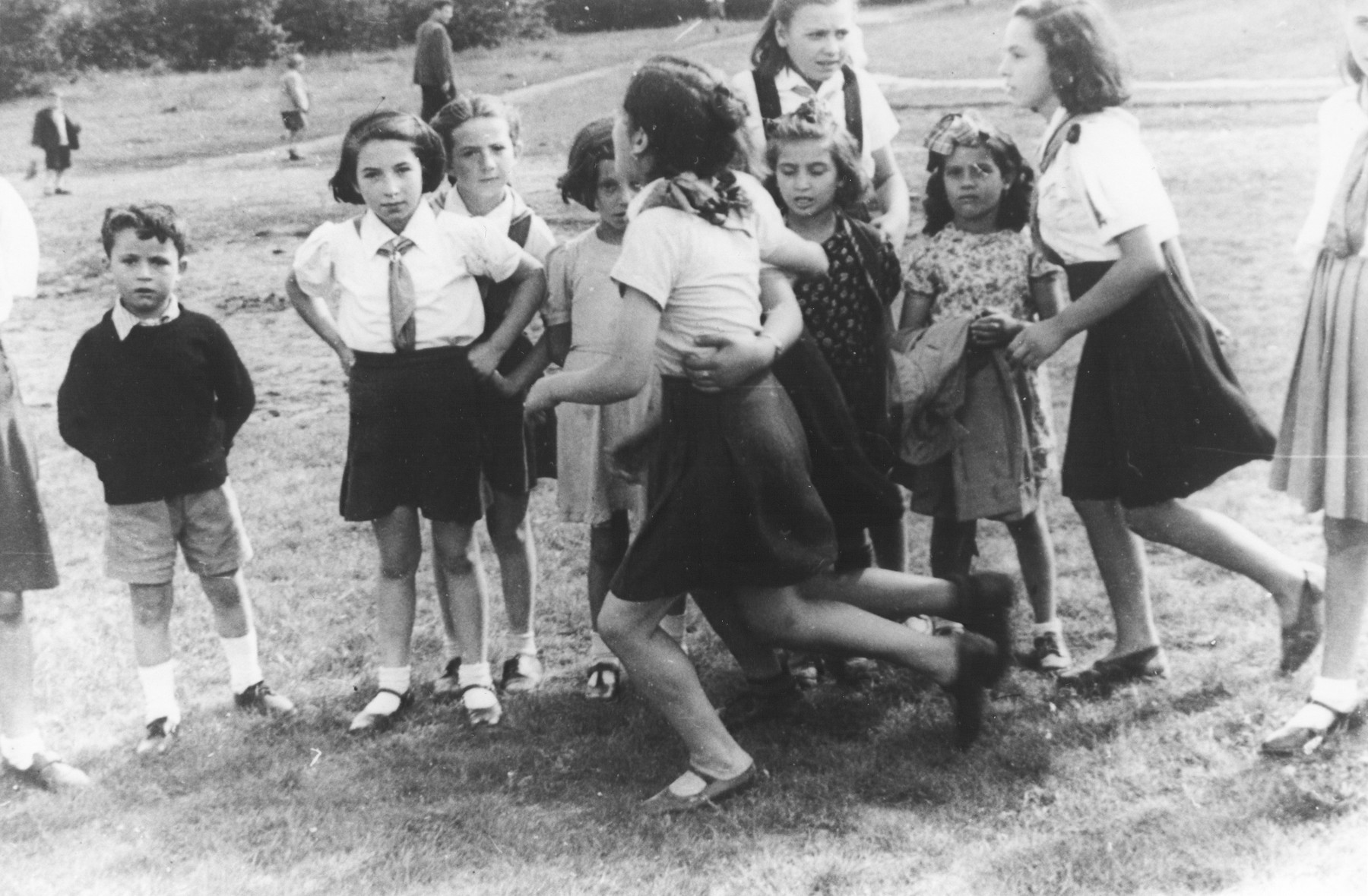 A group of  young Jewish girls play outside in a summer camp for Jewish DP children in the Grunewald Forest.