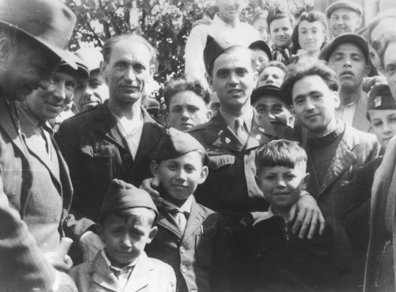 U.S. Army chaplain Rabbi Mayer Abramowitz poses with a group of adults and children at a summer camp for Jewish DP children in the Grunewald Forest.