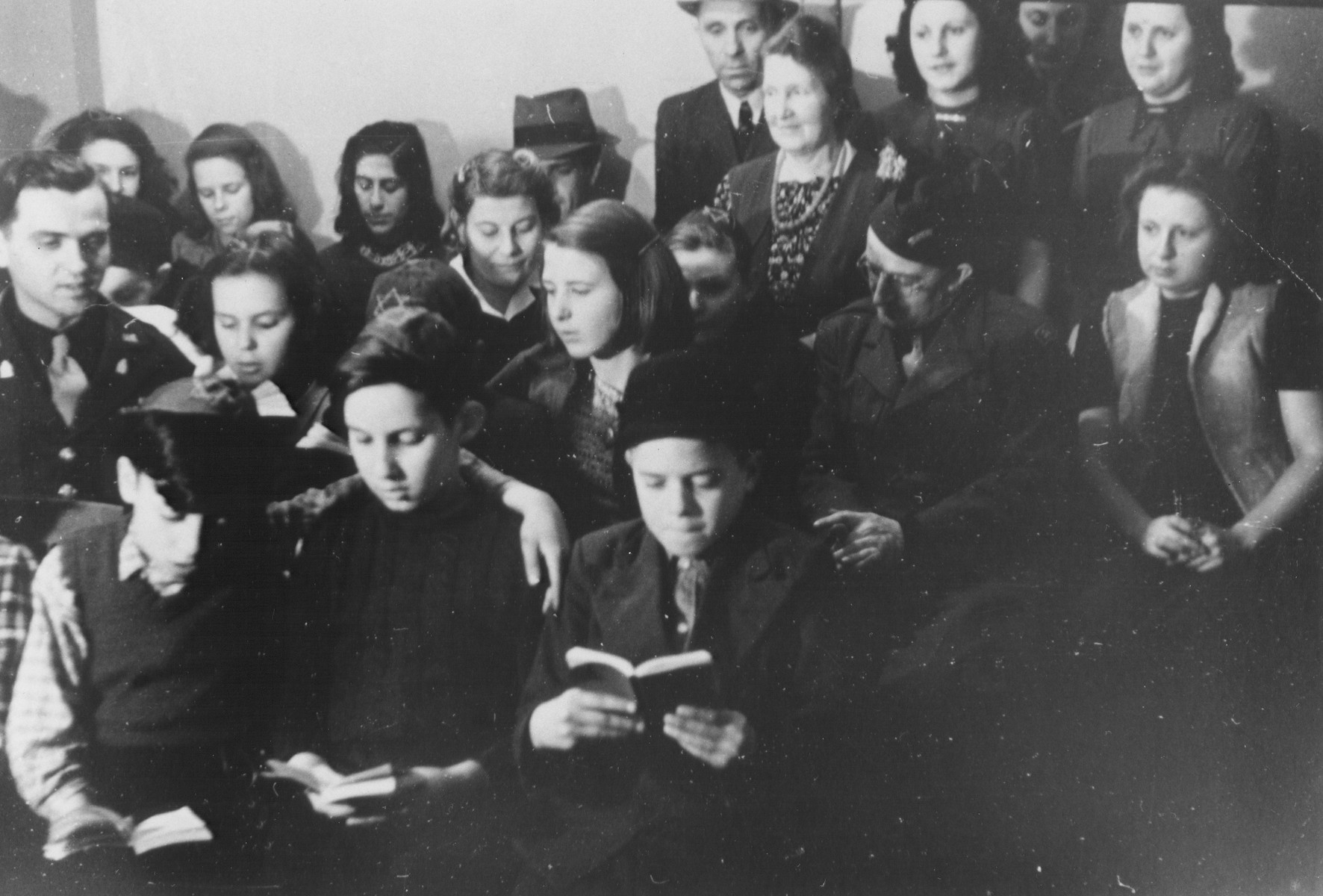 U.S. Army chaplain Rabbi Mayer Abramowitz assists students in the Jewish (Deutsche Juedische Jugend) school at the Berlin Chaplains' Center.  Abramowitz is pictured on the left in uniform.