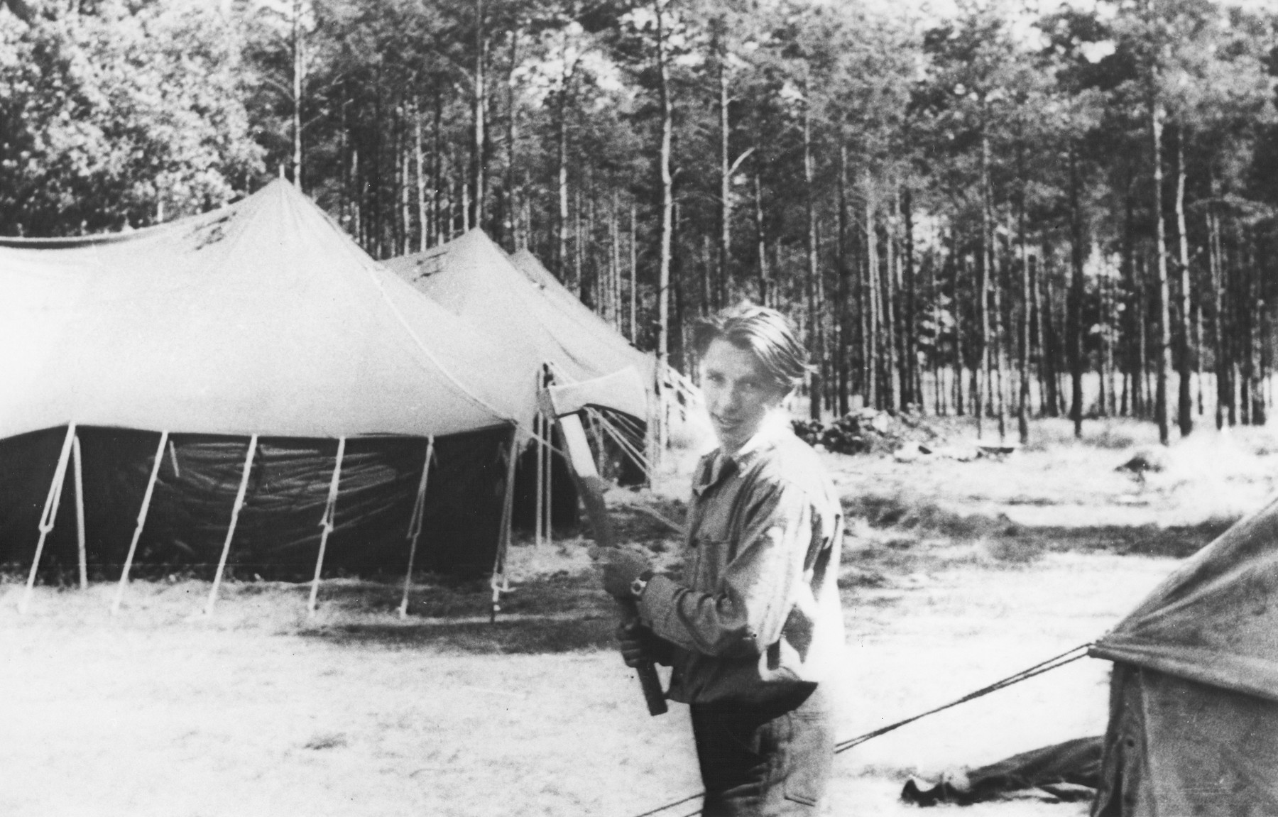 A Jewish youth poses with an ax at a summer camp for Jewish DP children in the Grunewald Forest.