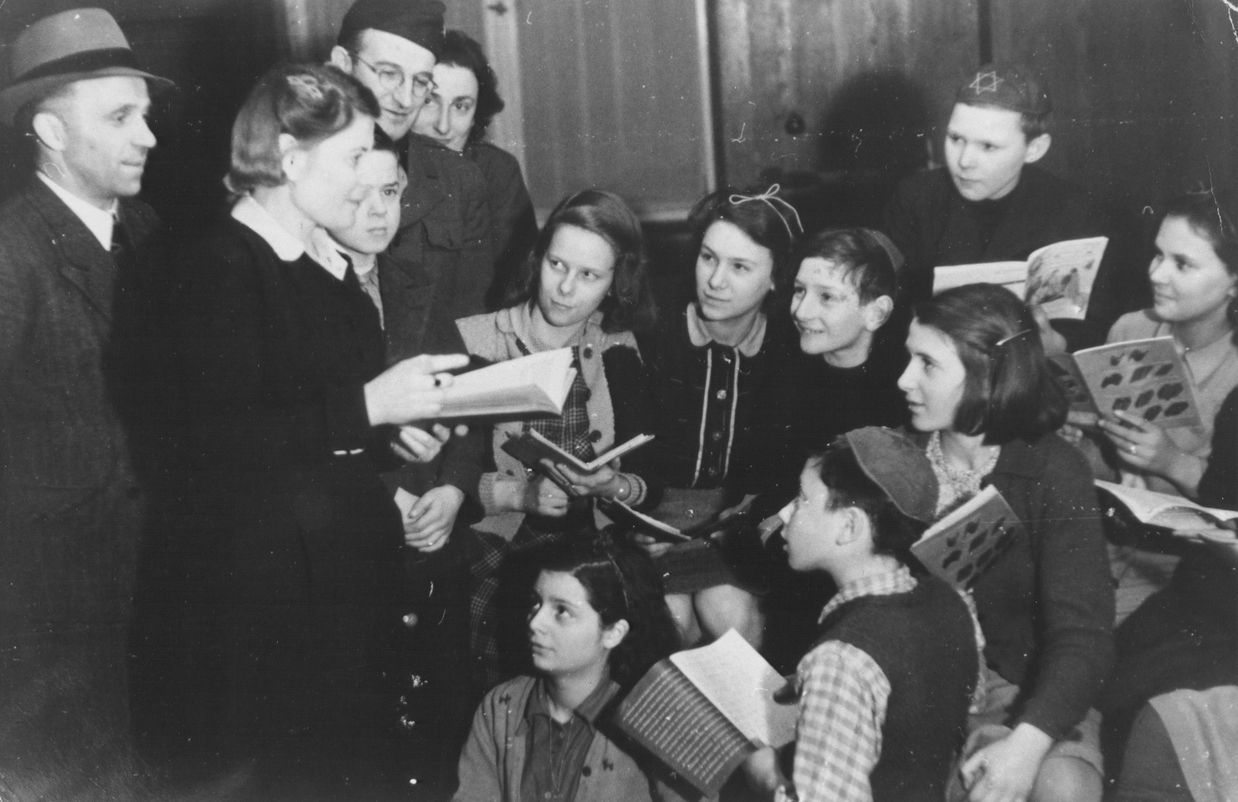 A female teacher conducts a class for Jewish DP children in the Jewish (Deutsche Juedische Jugend) school at the Berlin Chaplains' Center.
