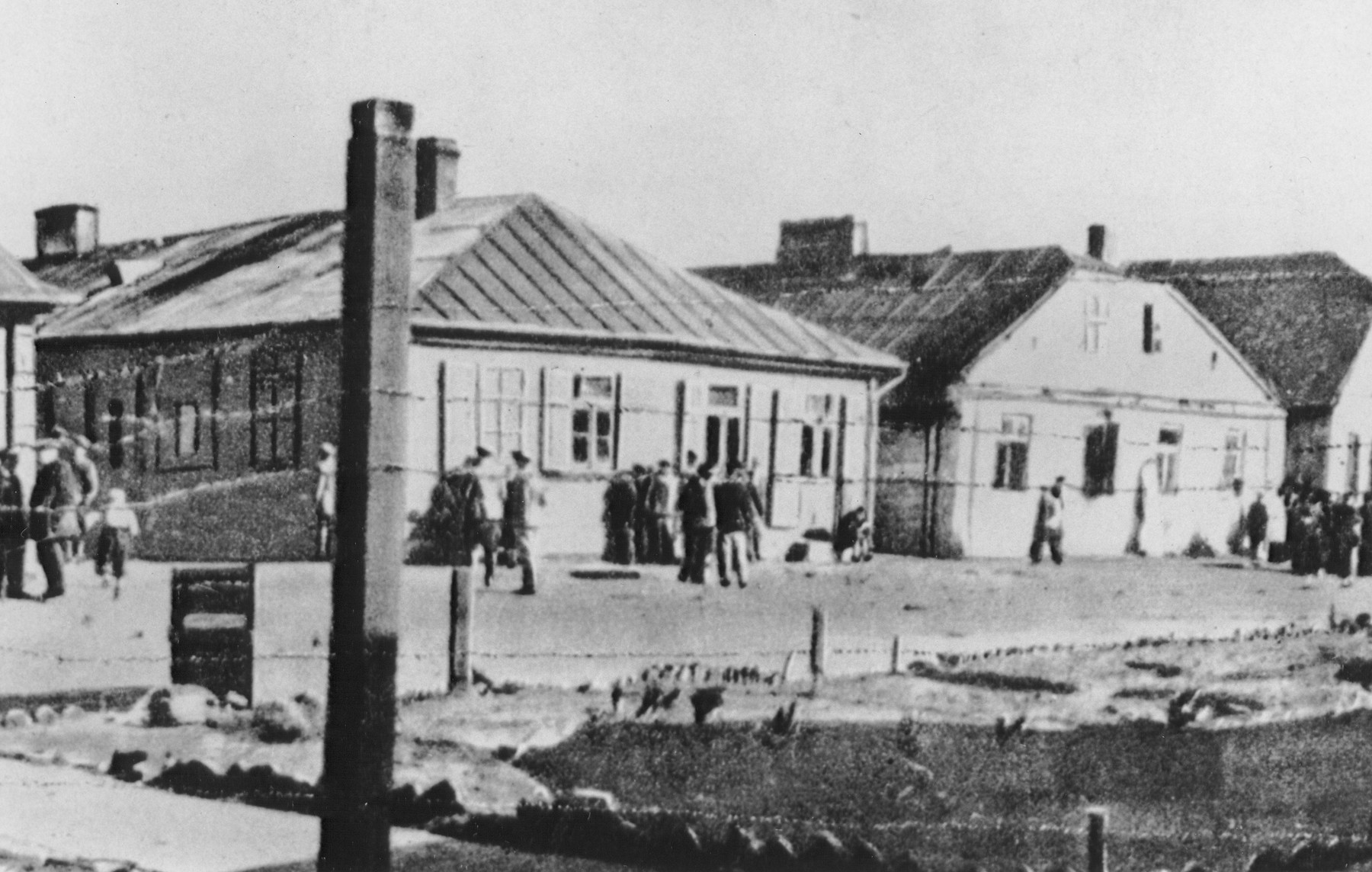 A section of the Miedzyrzec Podlaski ghetto as seen through the barbed wire fence that surrounded it.