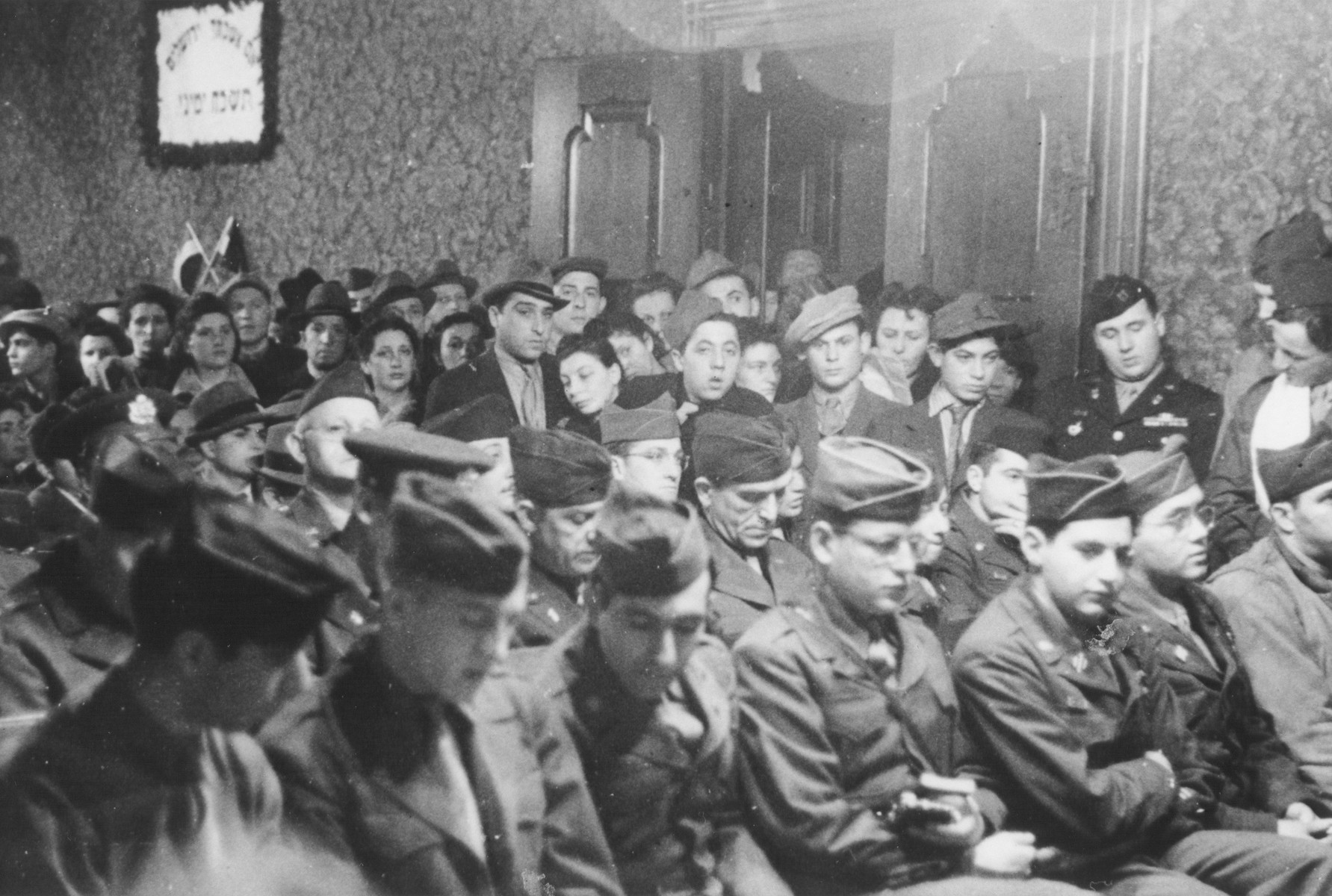 View of the audience of American soldiers and Jewish DPs at the rededication of a synagogue in Marburg.    The previous synagogue was destroyed during Kristallnacht.