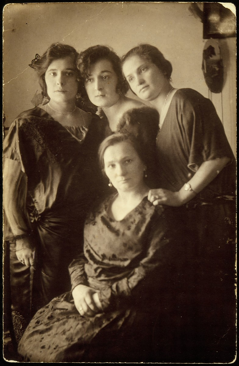 Portrait of the three Zlotnik sisters Hayya Fradl, Bluma, Menuha with their niece, Dora.   From right to left: Bluma Zlotnik Michalowski, Dora Zlotnik Berkowitch, Menuha Zlotnik Sheshko.  Sitting is Hayya Fradl Zlotnik Broide.  Dora immigrated to Palestine. Menuha died in childbirth.  Bluma and Hayya Fradl were murdered by the Lithuanian collaborators as they tried to escape the September 1941 massacre in Eisiskes.