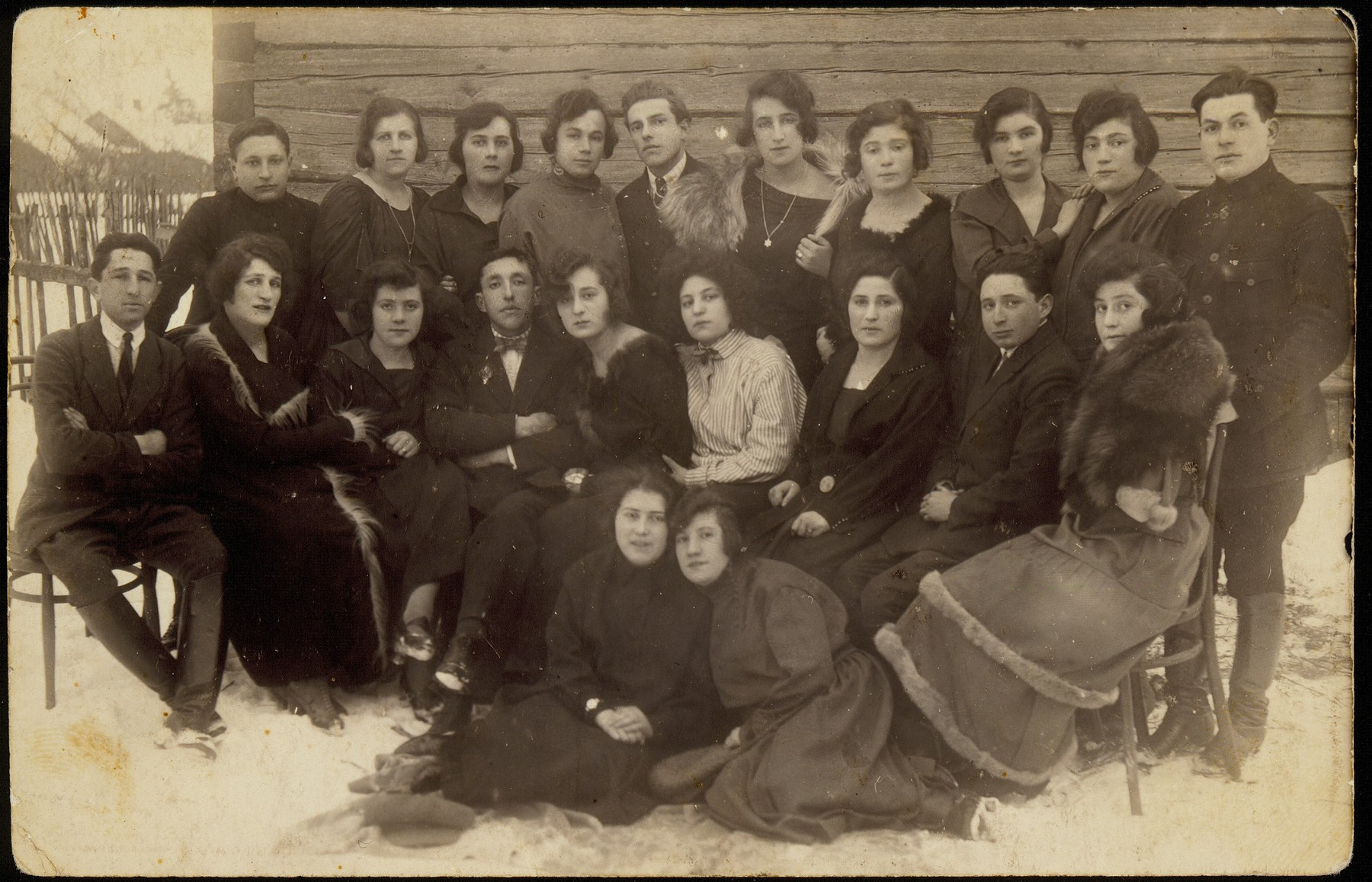 A group of young people pose outdoors in the snow.   Standing at the far right, Israel Pogarelsky.  The man in the middle is Uri Rozowski and on the far left is Leibe Glombocki.  Middle row, from right to left:  Hannah Koppelman Pogarelsky, Naftali Berkowicz, unknown, Rachel Kaleko, Dora Zlotnik Berkowitch, Shlomo Kiuchefski, others are unknown. Sitting on the ground, on the left, is Bat-Sheva Rozowski.    Uri Rozowski, Naftali Berkowicz, Rachel Kaleko, Dora Zlotnik Berkowitch immigrated to Palestine.  Shneur Glombocki survived the Holocaust as a partisan. Shlomo Kiuchefski was murdered by members of the Polish Home Army.  Israel Pogarelsky was murdered in the Radun ghetto; his wife Hannah Koppelman and their children also perished during the Holocaust. Bat-Sheva Rozowski and her family were murdered in Treblinka.  The fate of others is unknown.