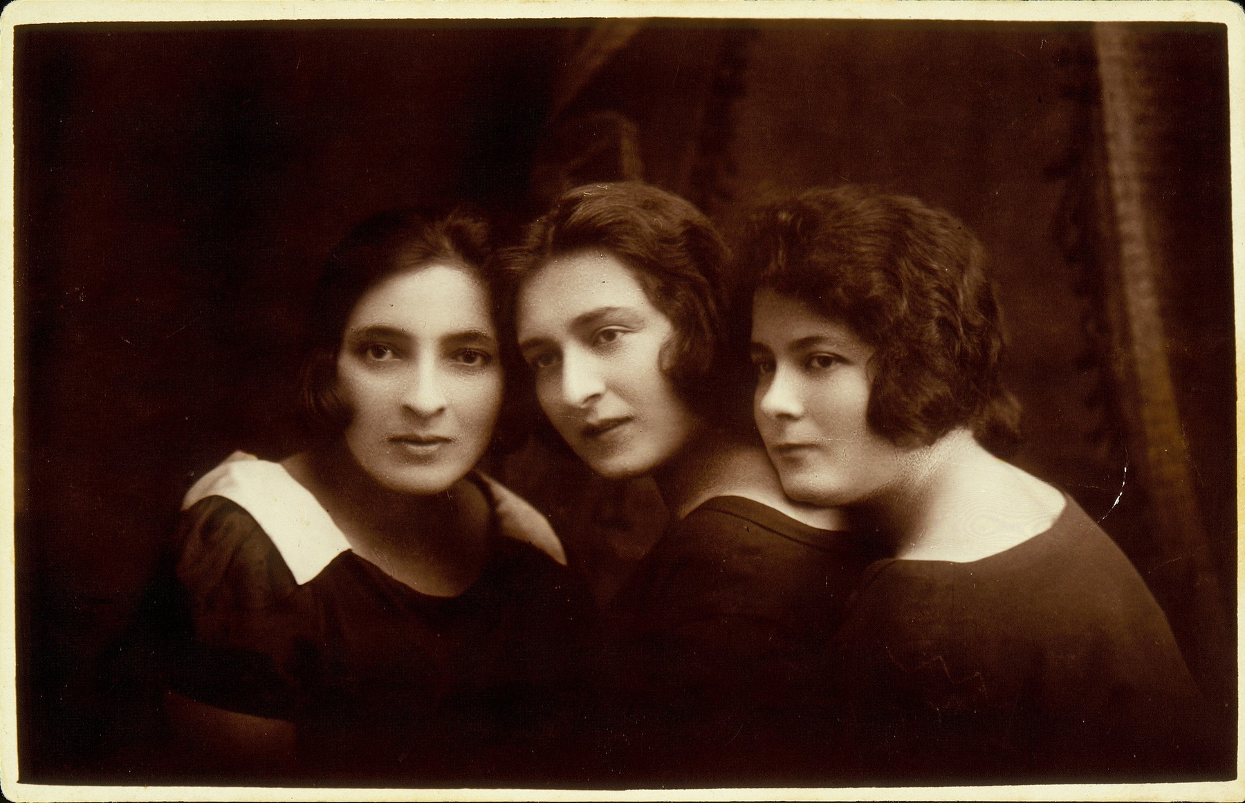 Studio portrait of three young Jewish women in Eisiskes.  Pictured from right to left are Gitta Oshochowski, Dora Zlotnik and Mira Iasinowski.  The photograph was taken on the occasion of Dora's departure for Palestine. Gitta and her family were killed in the Lida ghetto on May 8, 1942.