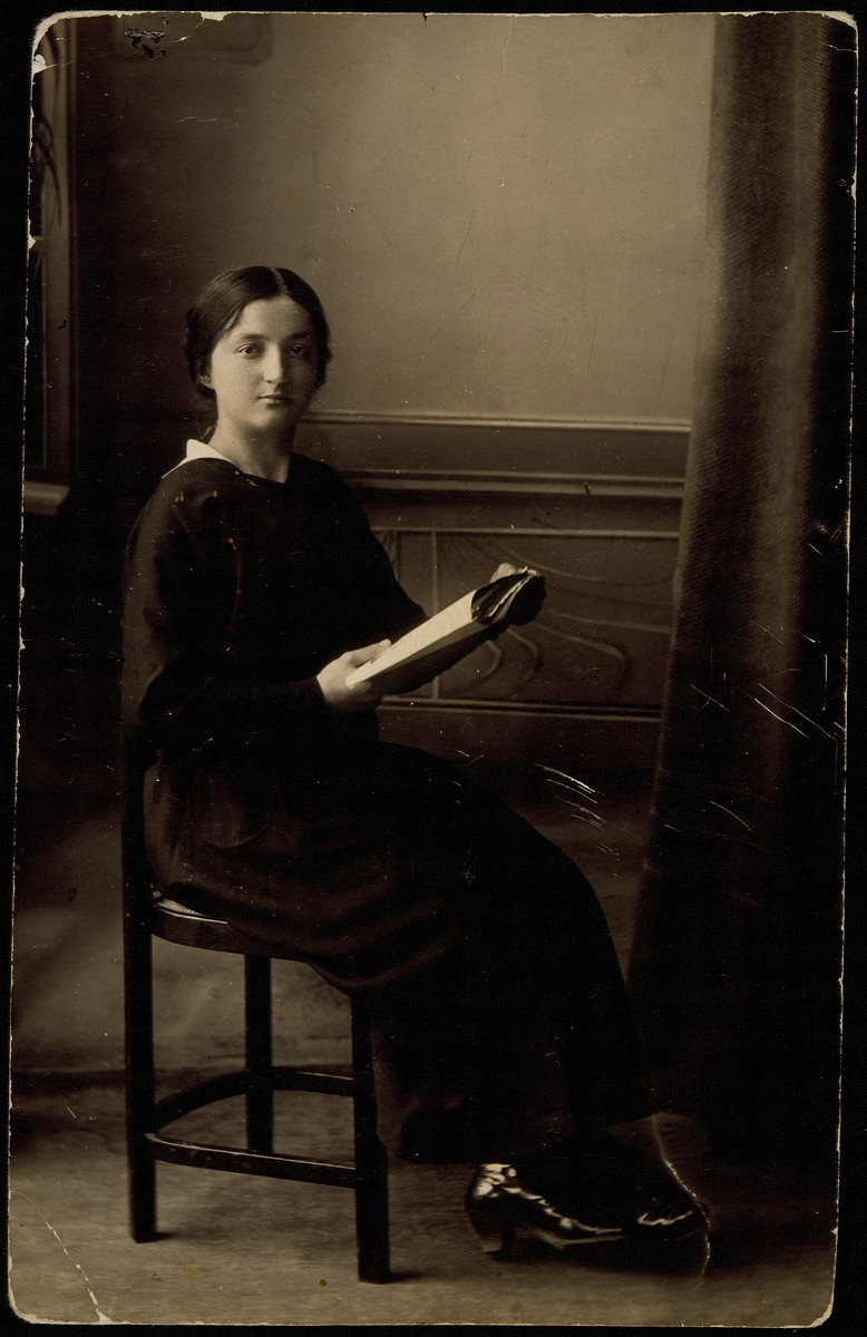 Portrait of Hinda Sonenson Tawlitski reading a book.  Hinda Sonenson, the sister of Moshe Sonenson, was a student in the first class of the female school in Eisiskes.  Her husband Rabbi Ben Zion Tawlitski immigrated to the United States.  The American Embassy in Warsaw refused to issue her a visa.  She and her four children were killed by the Germans during the September 1941 mass shooting action in Eisiskes.