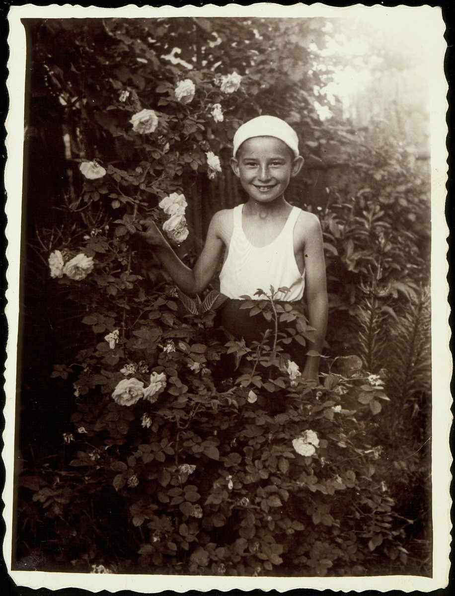 Yudaleh Kabacznik in the flower garden of Hayya Sonenson.    Yudaleh was murdered by the Polish Home Army in February 1944.