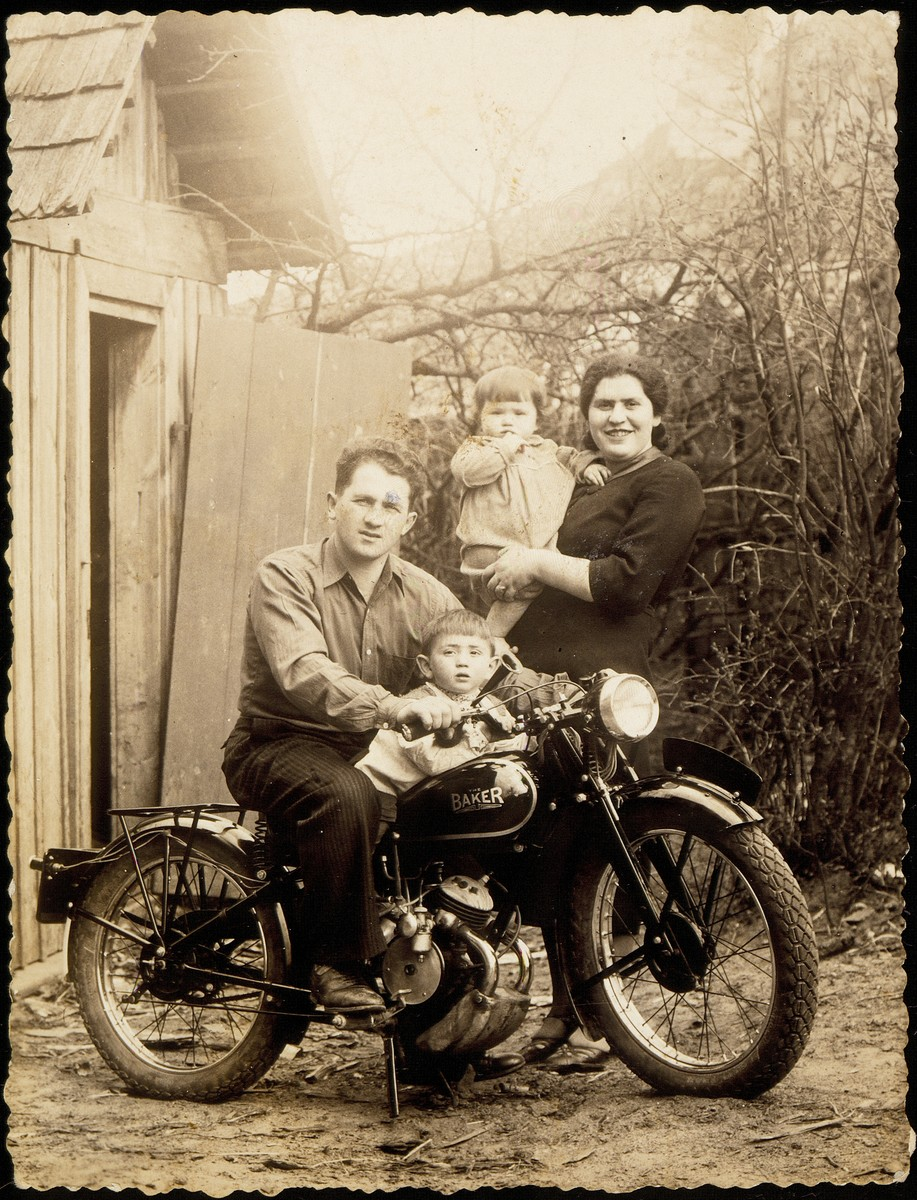 The Rushkin family poses with their new motorcycle.   Pictured are  Avraham, his son Elisha, wife Miriam (nee Koppelman), and daughter Sarale.