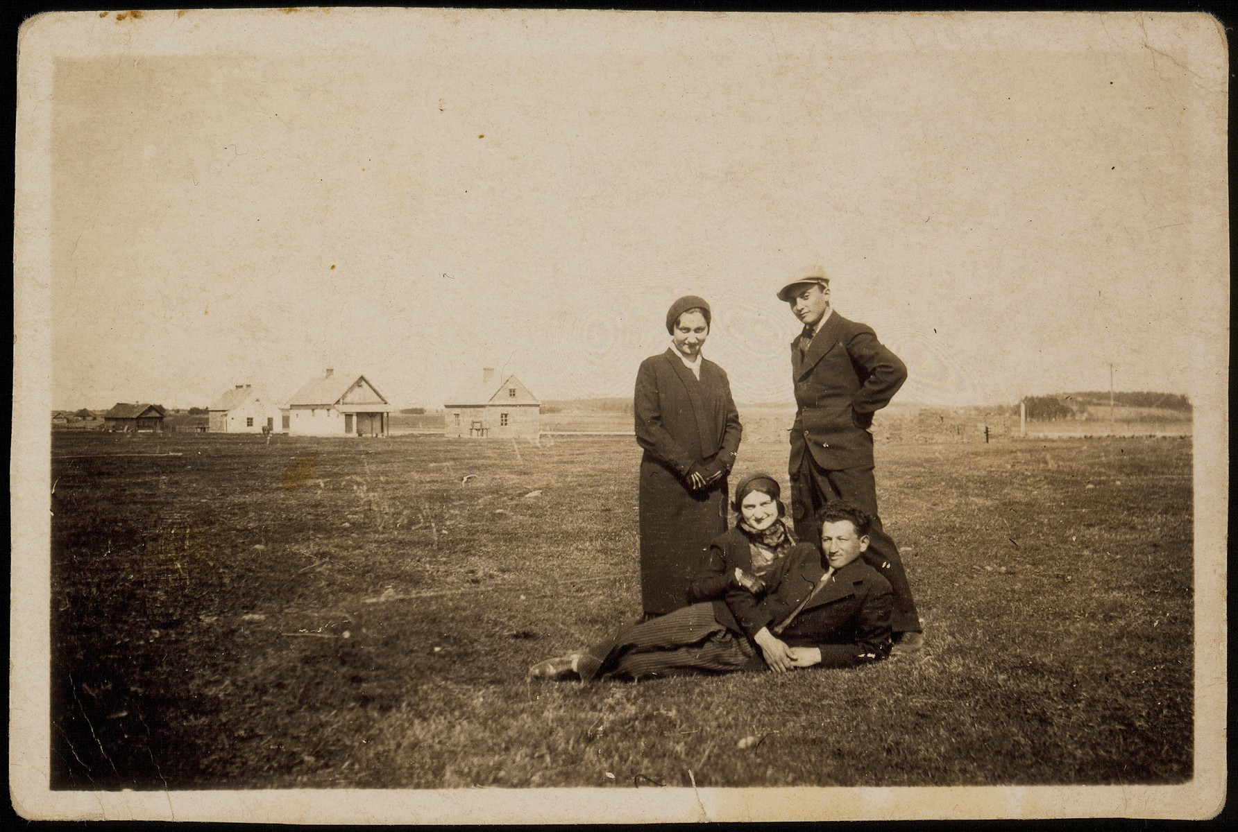 Members of the Sonenson family visit the shtetl Selo, a community for the insane.   Sitting on the ground is Leibke  (Aryeh) Sonenson and his wife Geneshe.  Leibke  (Aryeh) Sonenson and his wife Geneshe and their son, Meir were killed by the Germans during the September 1941 mass shooting action in Eisiskes.