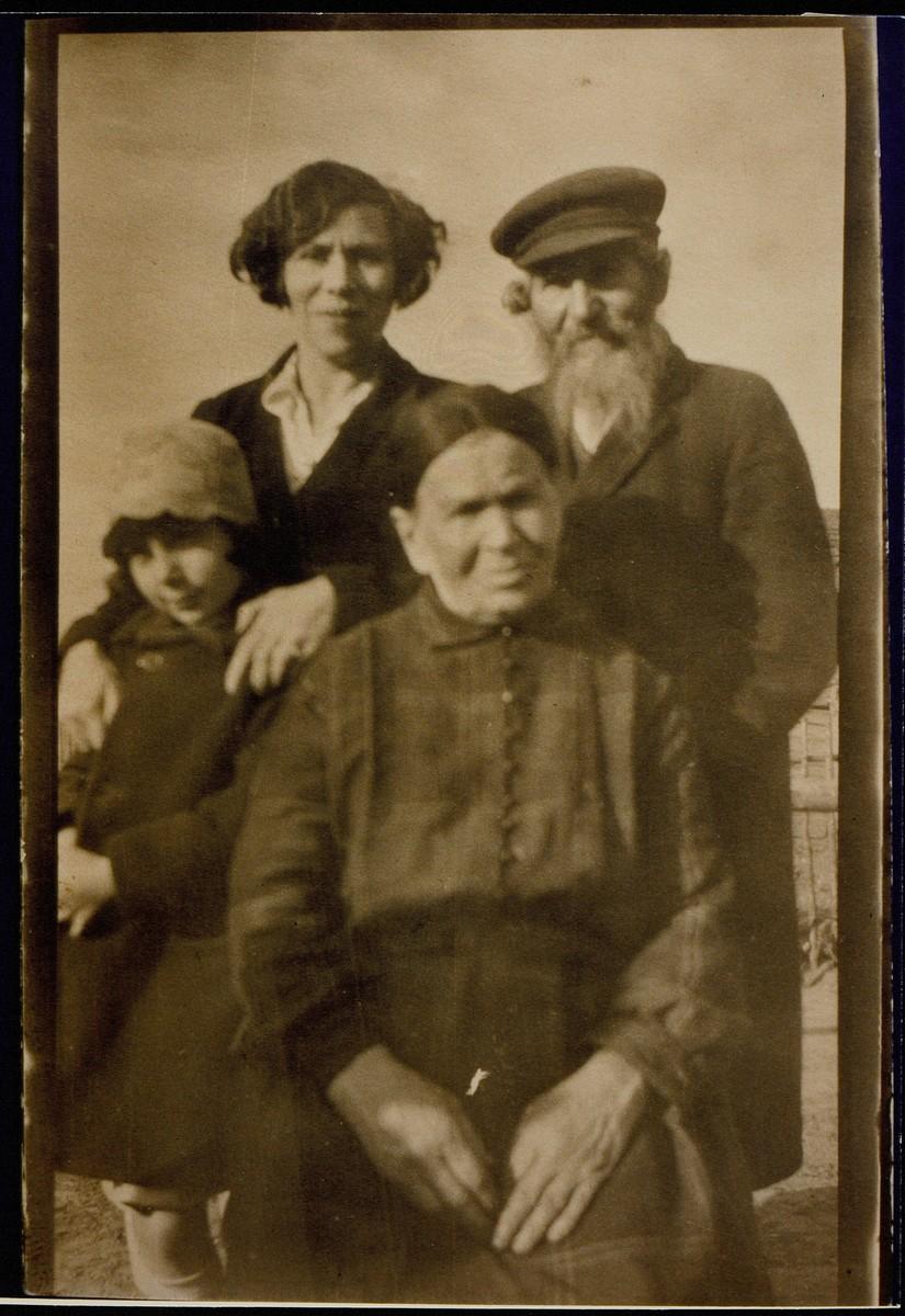 Portrait of a family taken outdoors in Eisiskes.