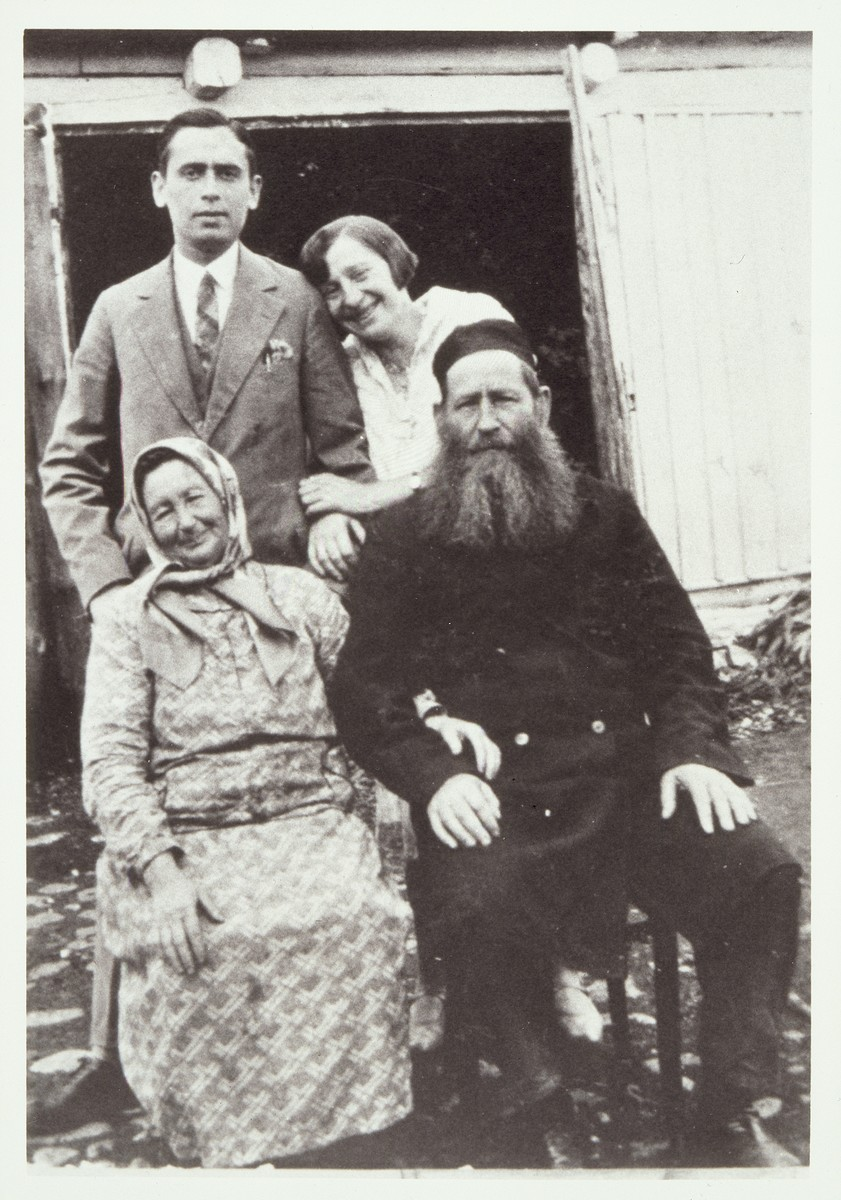 Two generations of the Moszczenik family pose outside their farmhouse in Eisiskes.