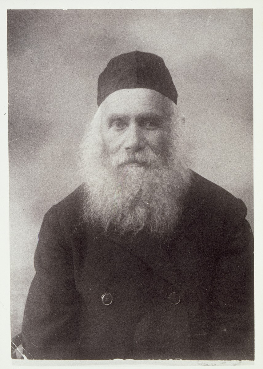 """Photo of Reb Arieh-Leib """"der Rubishker"""" (from Rubishok) Kudlanski, Eisiskes' milkman.   Every Saturday morning, he used to walk to the shtetl's Old Beth Midrash in his prayer shawl.  When he passed by, Christian and Muslim farmers removed their hats in his honor. All of his children immigrated to America.  He visited them but decided to return to Eisiskes stating that he did not like a country """"where people love more the people who walk on the walls [people in the movies] than real people who walk on the fields and streets.""""  When he was in  his eighties, the Germans cut his beard and then killed him during the September 1941 mass shooting action in Eisiskes."""