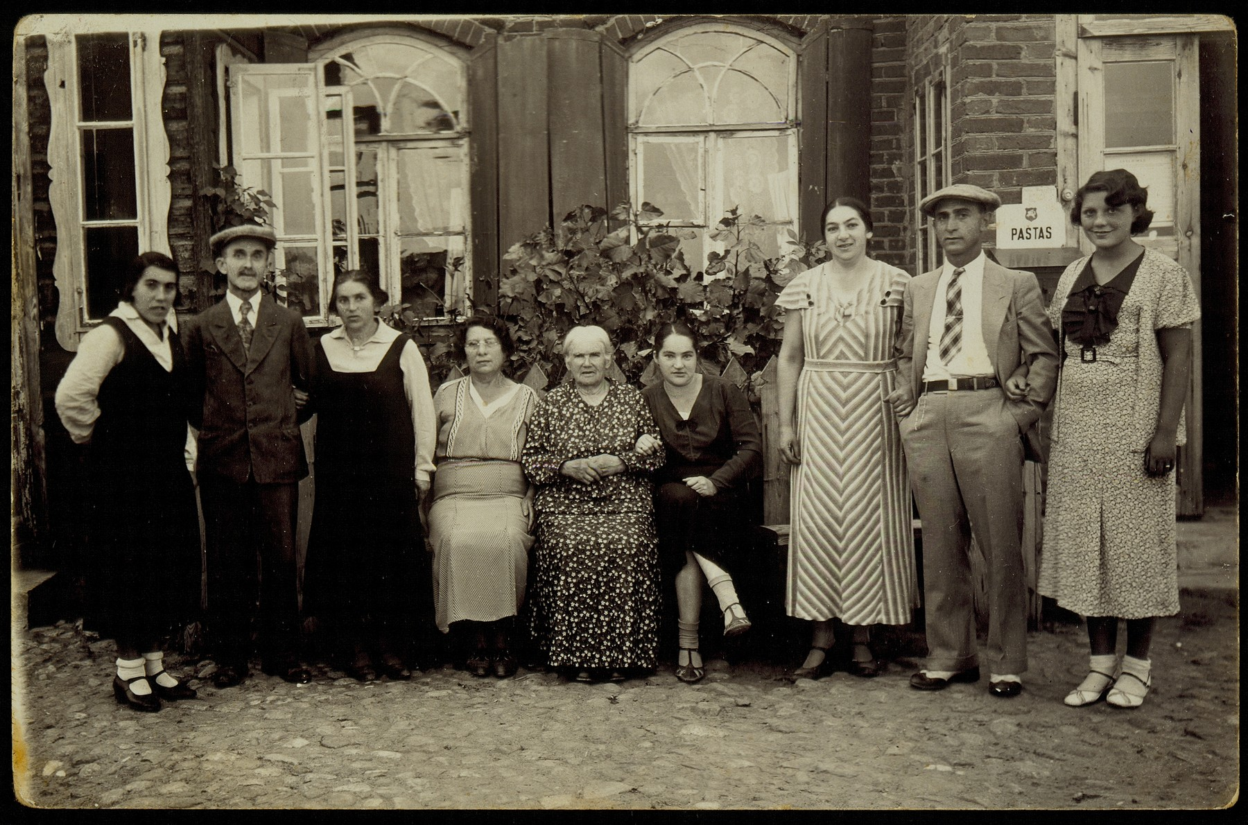 Members of the Zlotnik family gather in Aran on the occasion of a return visit by Yehuda-Leib Zlotnik from America.    From left to right: Frieda Shoob, Hirsh Pruser, Fradl, Kunie's sister and mother of Roslyn Kablin, Bertha Margolis, a U.S. citizen, Mirl Resnik, Kunie Zlotnik's mother, Shifra, Kunie's sister, Kunie Resnik Zlotnik, husband, Yehuda-Leib Zlotnik, Gladys Ball, Bertha Margolis' daughter, a U.S. citizen.   Mirl Resnik and her daughter Fradl were murdered by Lithuanians.  Shifra and her husband and three children were murdered in their home by the Germans in retaliation for the shooting of a German soldier while riding a motorcycle in the vicinity.  Kunie and Yehuda Zlotnik immigrated to Palestine.