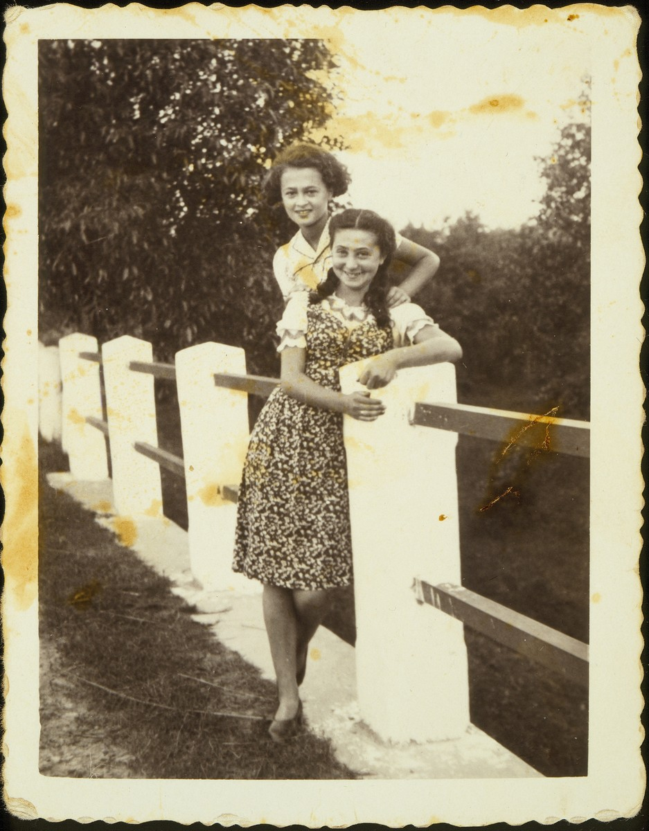 Two Jewish sisters pose on the bridge to Eisiskes.  Pictured are Sarah Michalowski (front) with her sister Leah.  Both were killed by the Germans during the September 1941 mass shooting action in Eisiskes.