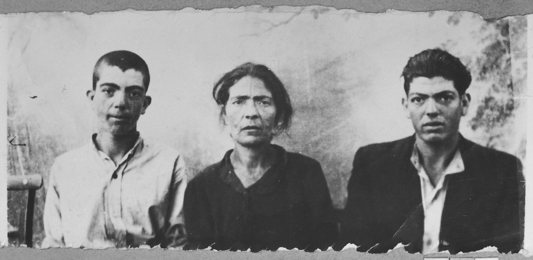 Portrait of Suncho Testa, [wife of Peris Testa], and Peris' sons, Yakov and Haim.  Yakov and Haim were laborers.  They lived at Orisarska 13 in Bitola.