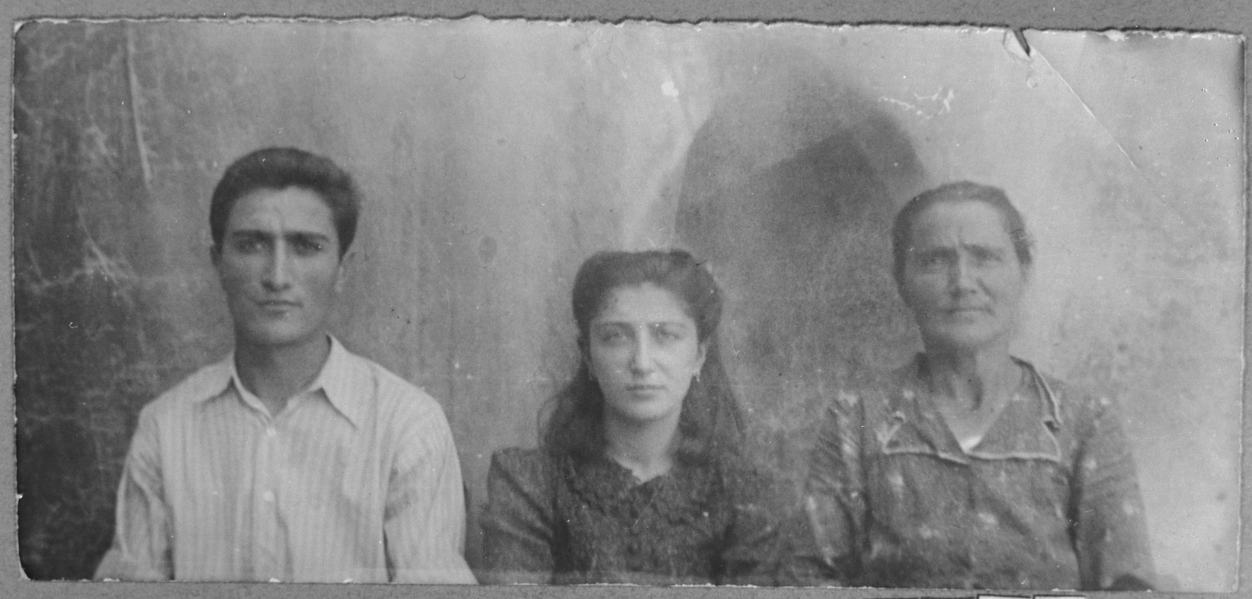 Portrait of Sol Hasson, wife of Avram Hasson, Isak Hasson, son of Avram, and Rahel Hasson, daughter of Avram.  Isak was a tailor and Rahel, a student.  They lived at Sinagogina 6 in Bitola.
