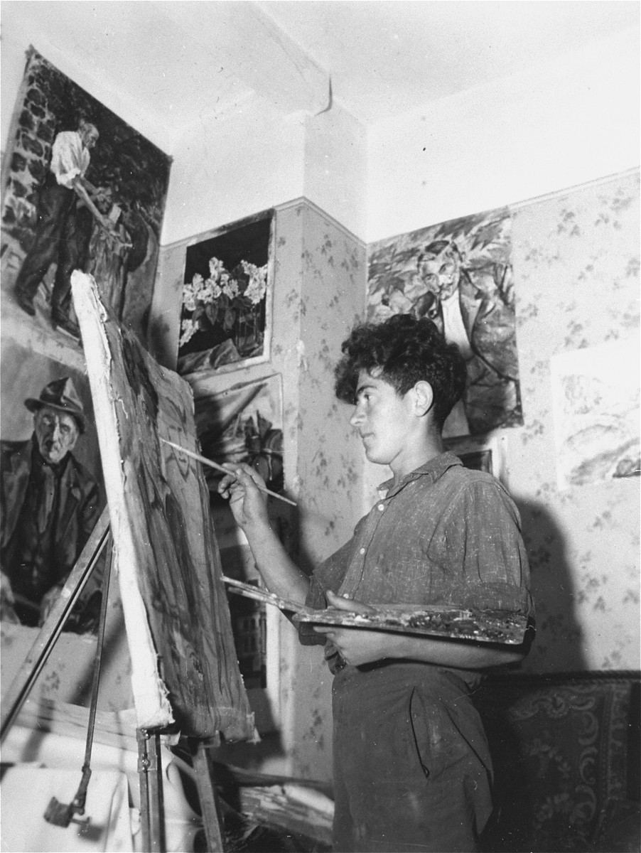 Twelve-year-old Shmuel Hilsberg paints in a studio at the Lindenfels displaced person's center for children.  The children's home was administered by the Hashomer Hatzair Zionist youth movement.