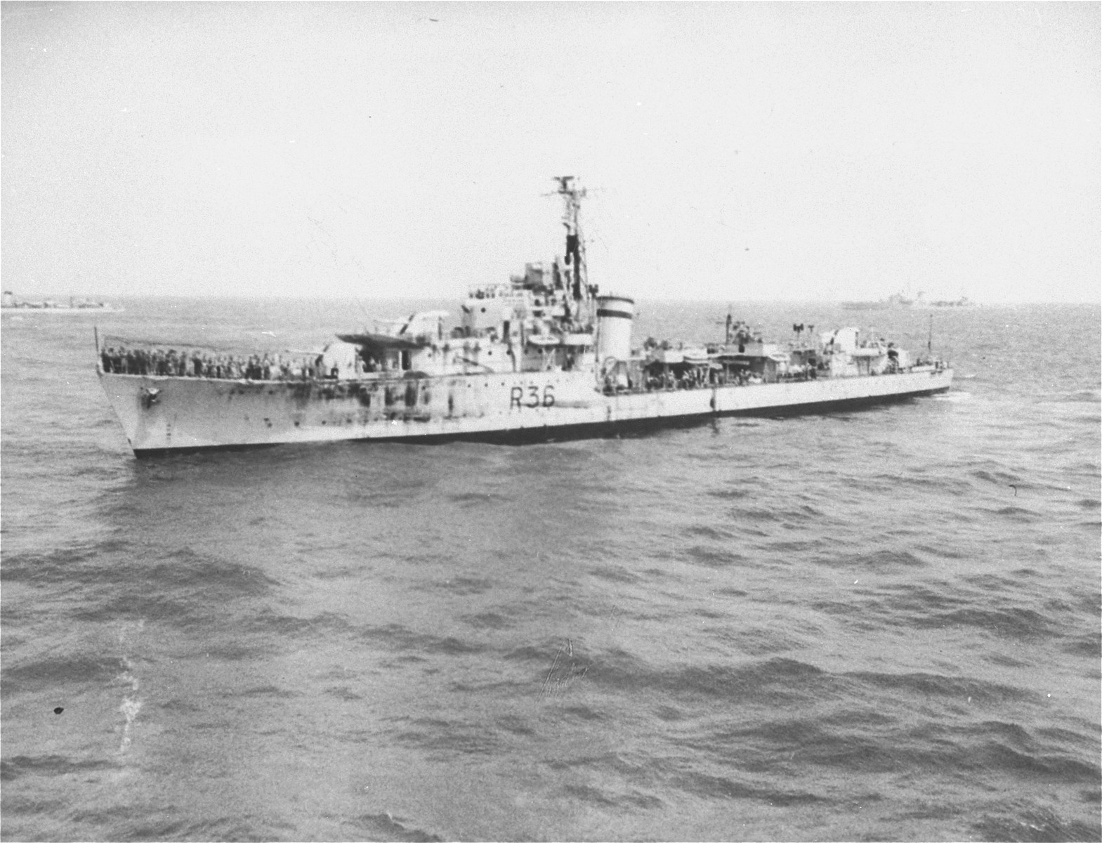 A British warship that has been dispatched to prevent the landing of the Exodus 1947, approaches the illegal immigrant ship off the coast of Palestine.