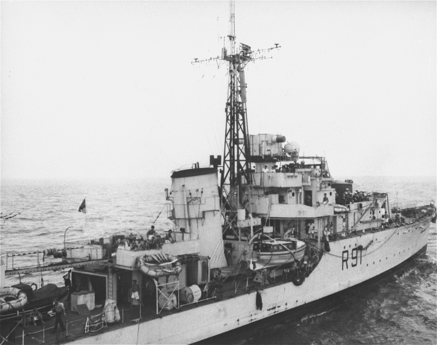 The British destroyer, H.M.S. Childers (R-91), closes in on the Exodus 1947 off the shore of Palestine.