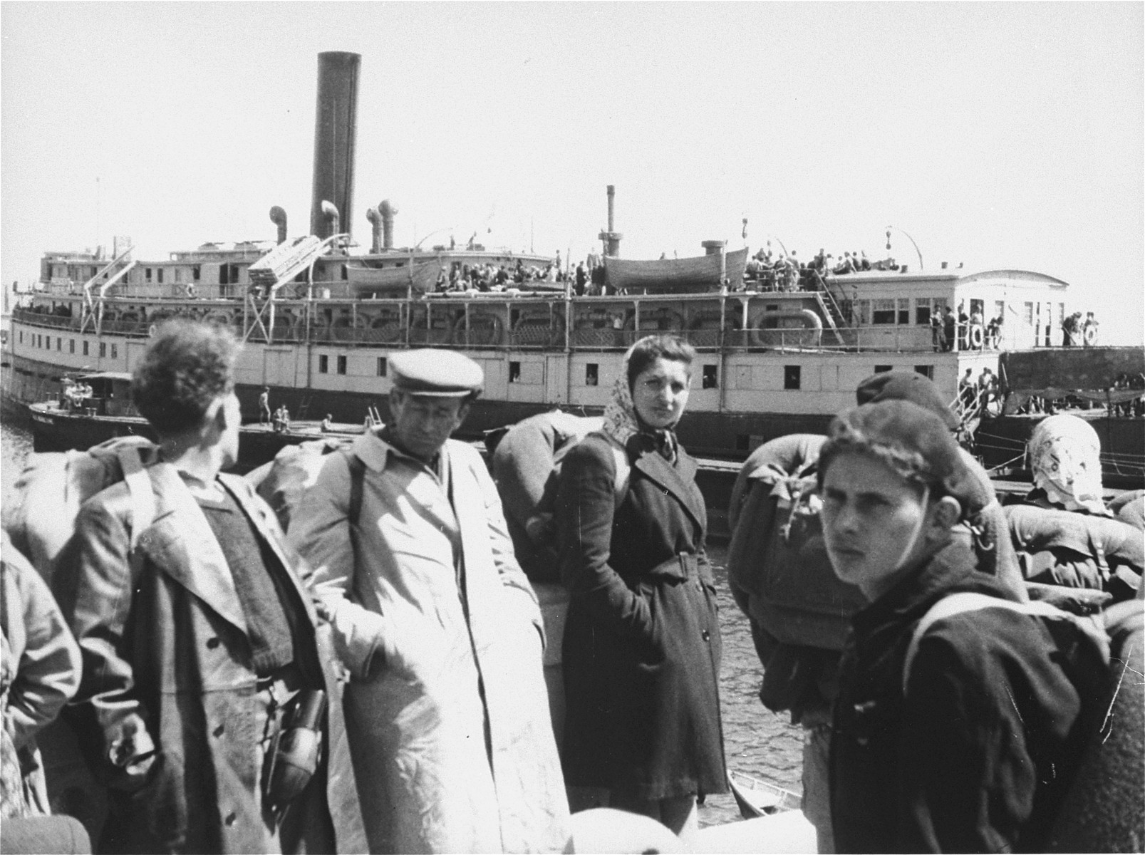 Exodus 1947 refugees wait to board the President Warfield on a quay in Sete's harbor.