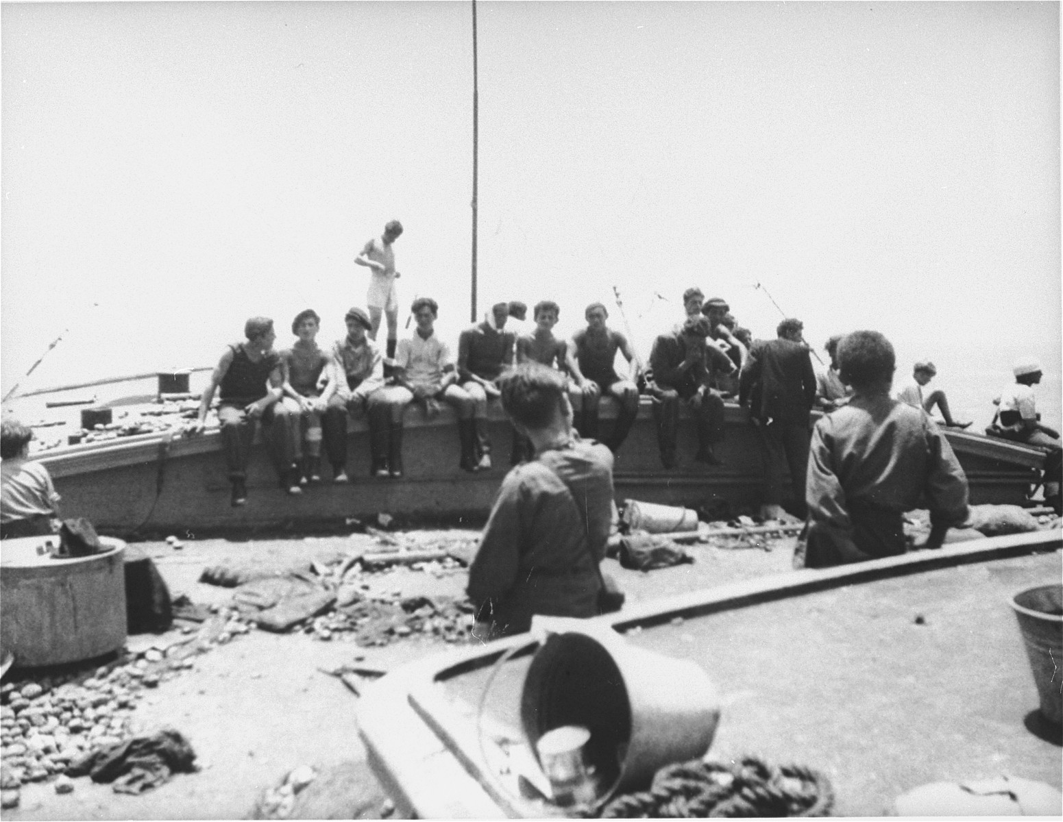 Jewish passengers rest on the deck of the Exodus 1947 amidst the debris from the previous night's struggle.